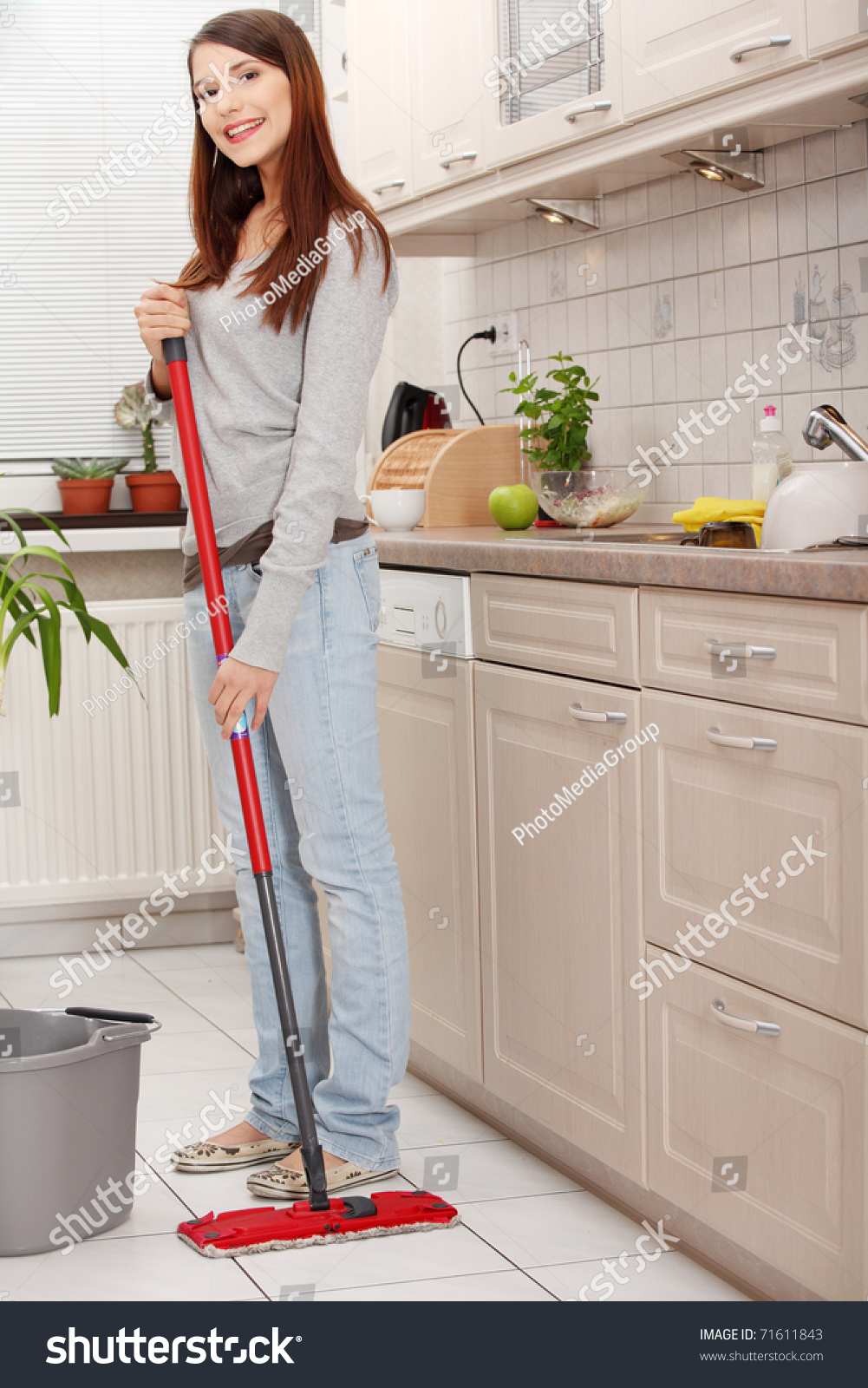 Kitchen Floor Mop Woman Holding A Mop And Cleaning Kitchen Floor Stock Photo