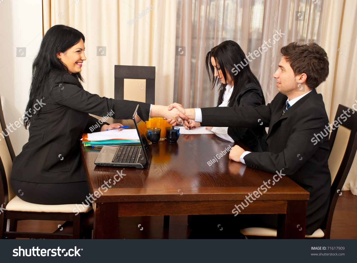 successful job interview two business people stock photo 71617909 successful job interview two business people giving hand shake and smiling