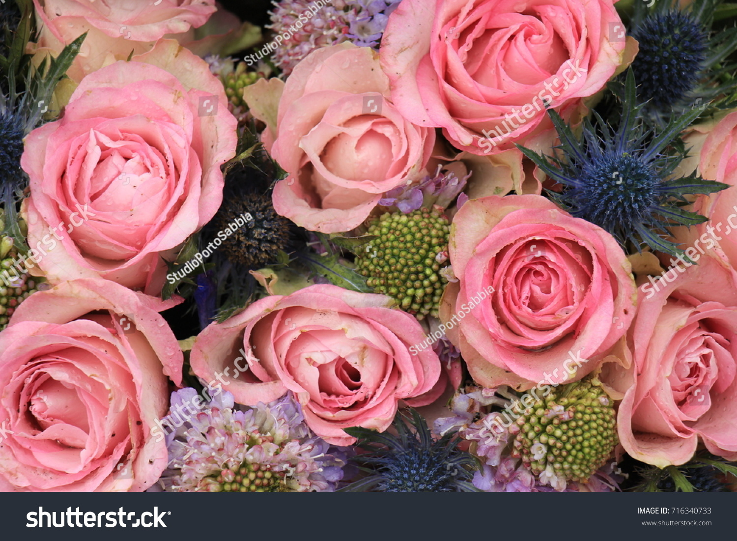 Pink Roses And Blue Sea Holly In A Wedding Flower Arrangement Ez