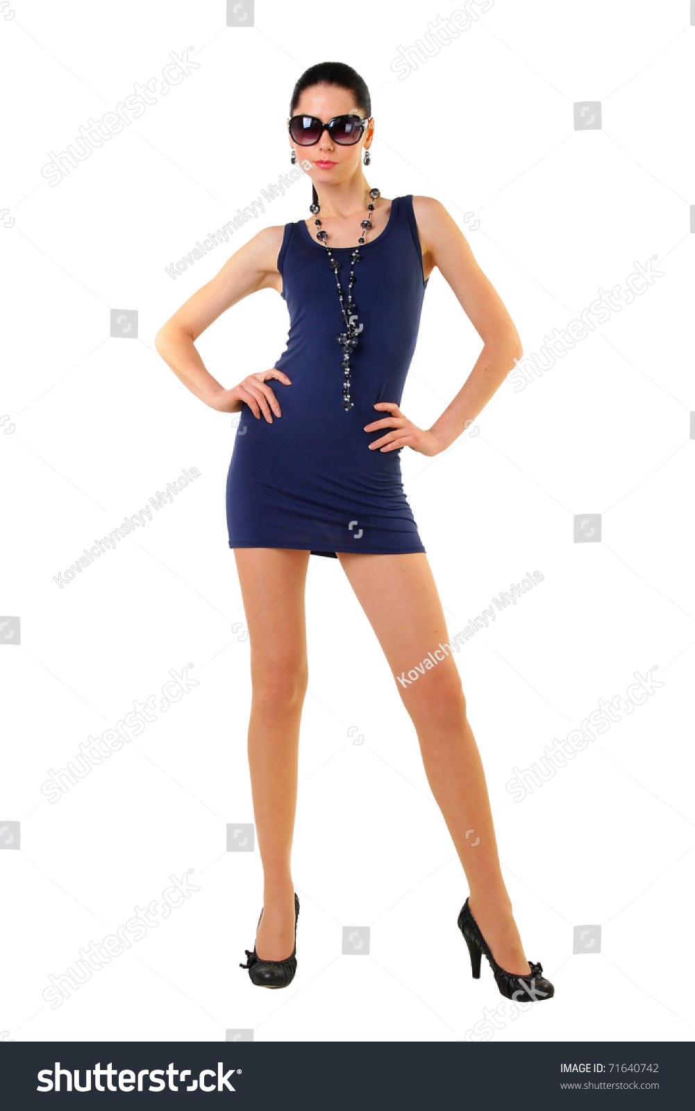 Thelongleggedstyleblogger: Sexy Fashion Model With Long Legs Posing On The Isolated
