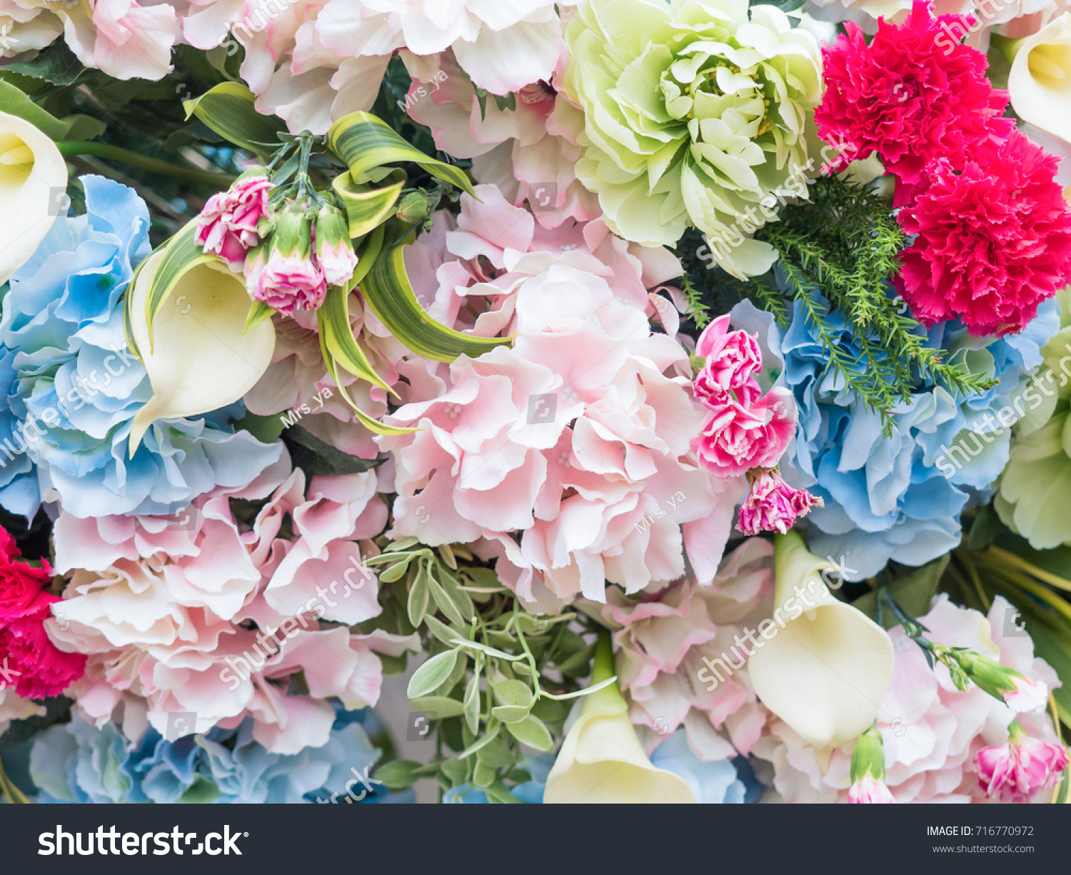 Beautiful Artificial Flowers On Artistic Background Stock Photo