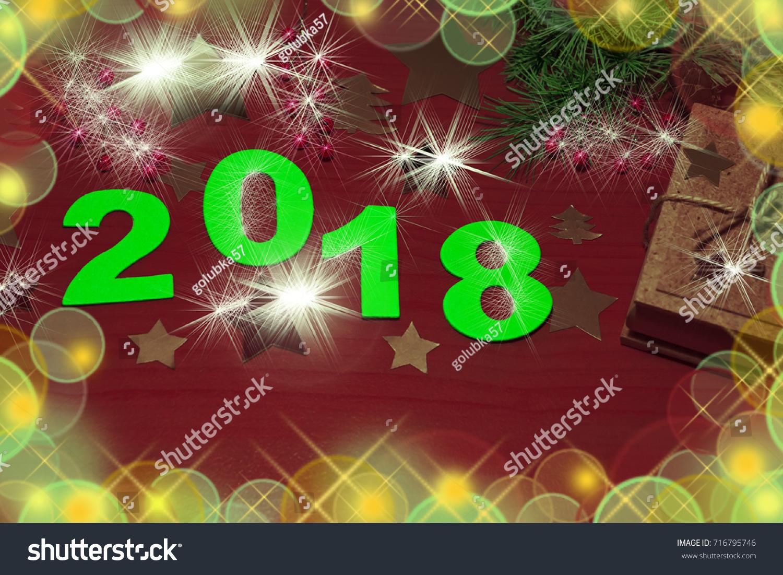 happy new year 2018 natural dark wooden background gift fir branch decoration blur