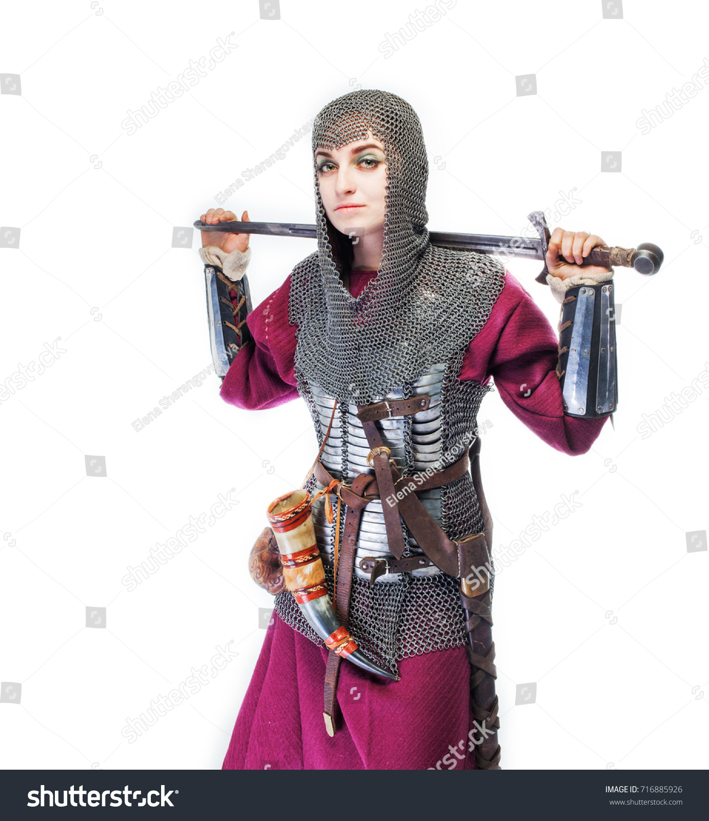 Girl warrior chain mail sword hand stock photo 716885926 girl warrior in chain mail and with sword in hand woman viking in historical battle sciox Choice Image