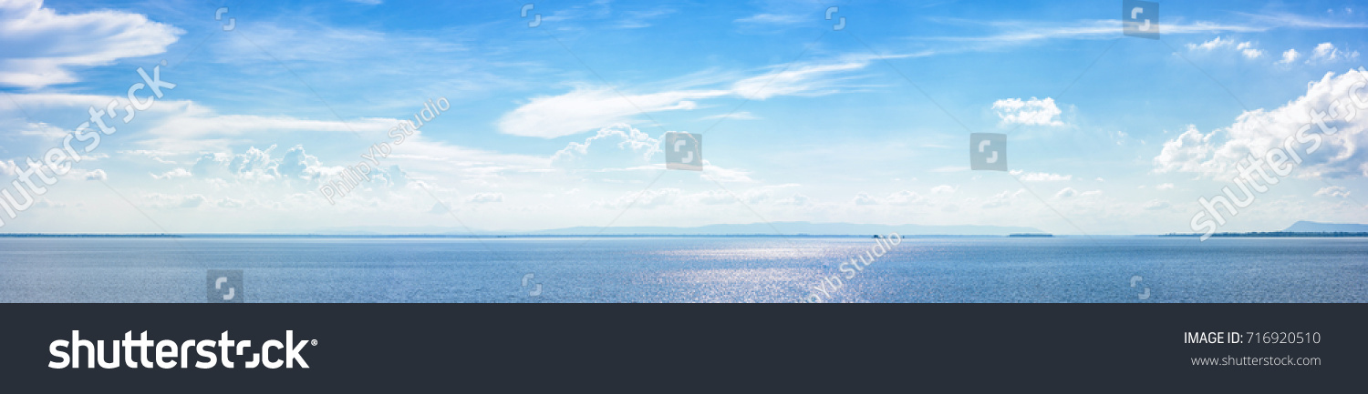 Panoramic beautiful seascape with cloud on a sunny day. #716920510