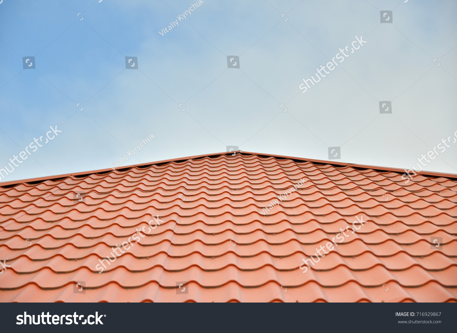 Dark red ceramic tile roof against stock photo 716929867 dark red ceramic tile roof against blue sky dailygadgetfo Images