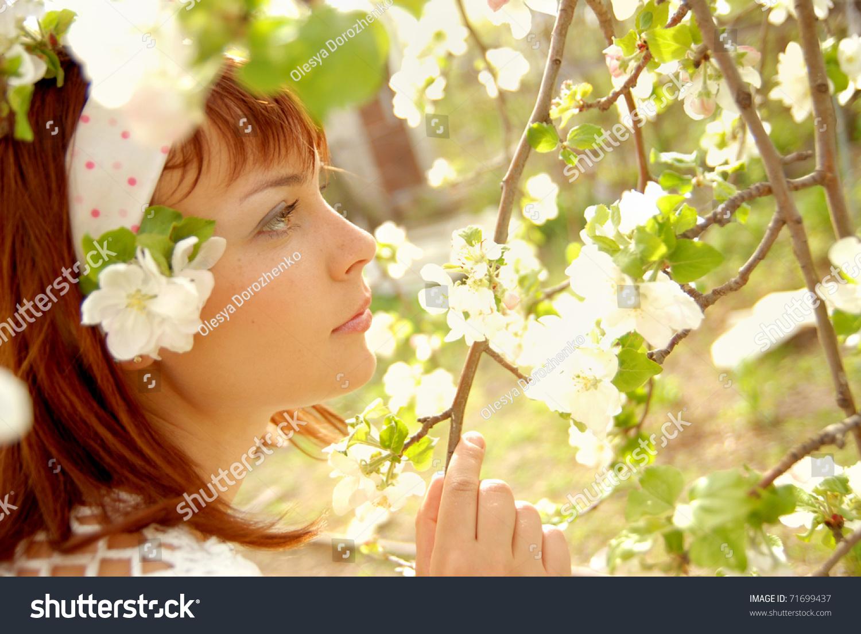 Beautiful young girl profile looks beautiful stock photo edit now beautiful young girl in profile looks at the beautiful flowers of apple tree izmirmasajfo