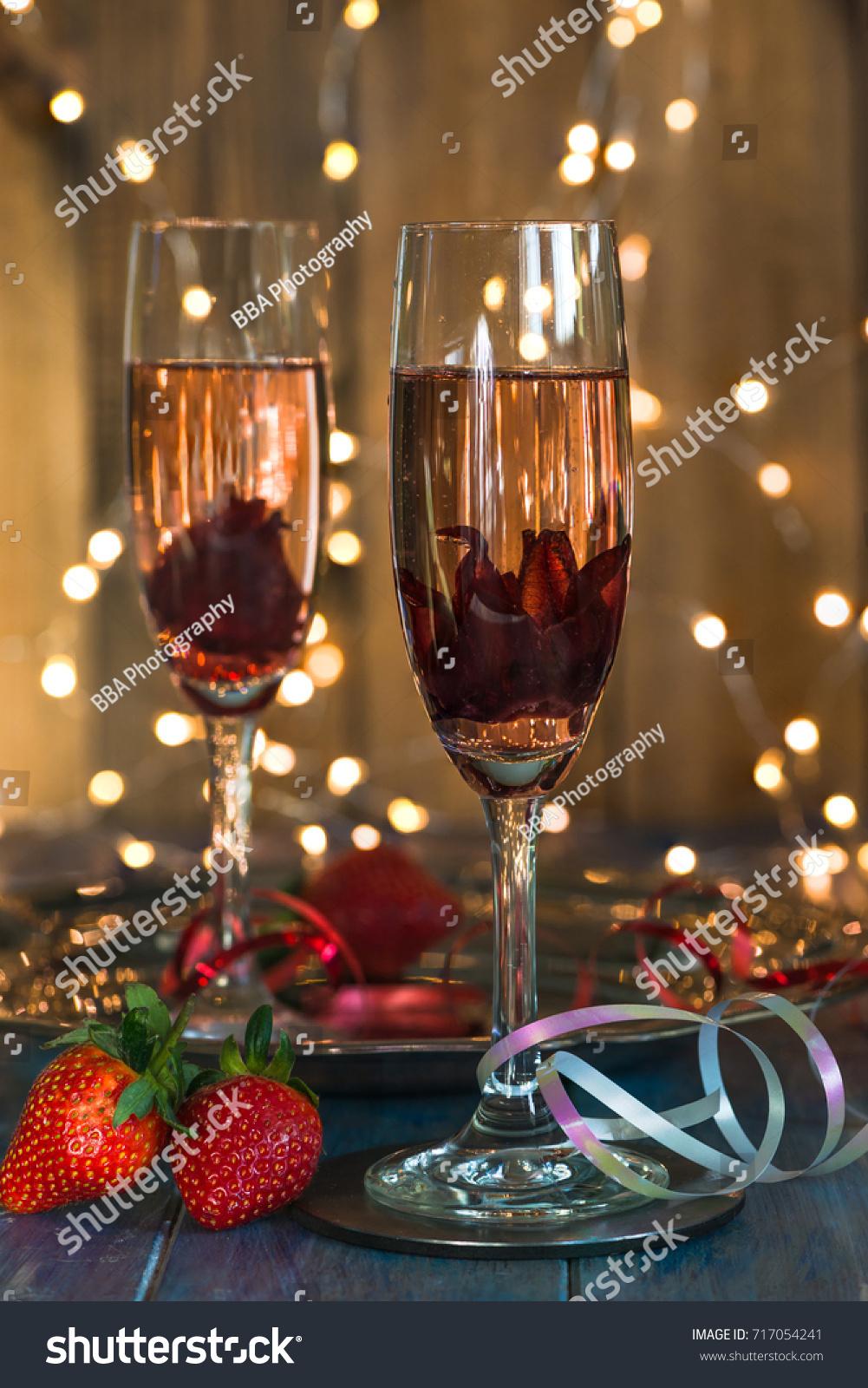 Champagne Glasses Hibiscus Flower Inside Strawberries Stock Photo