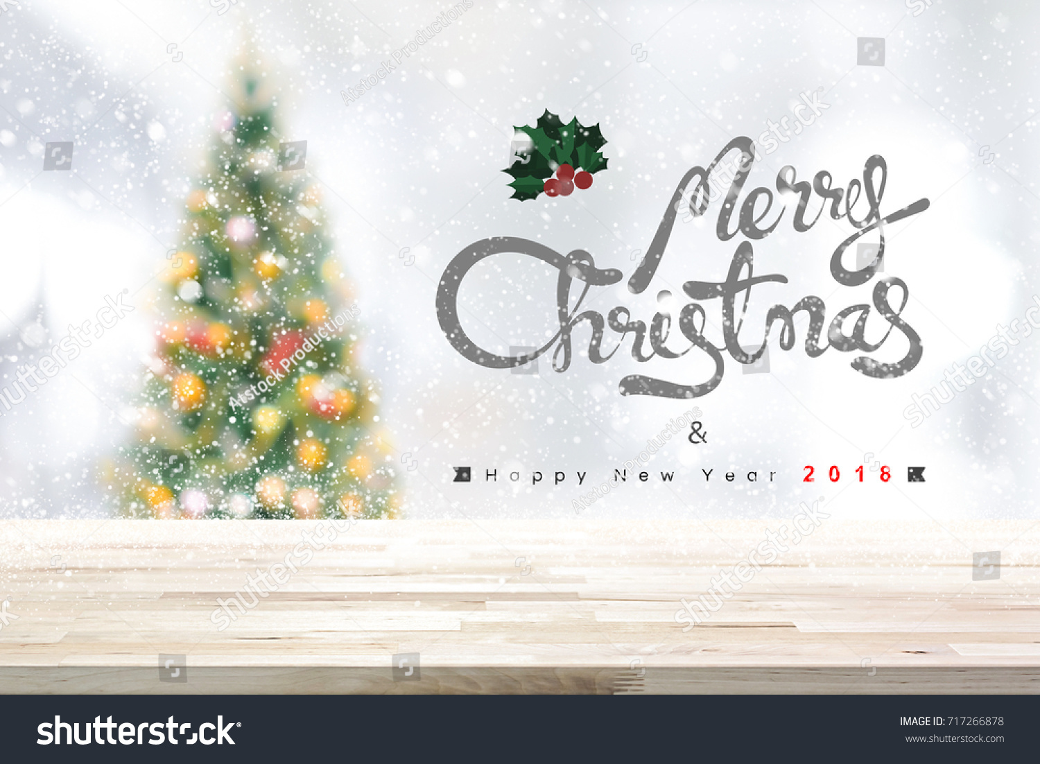 merry christmas and happy new year 2018 background with wood table top blurred decorated pine