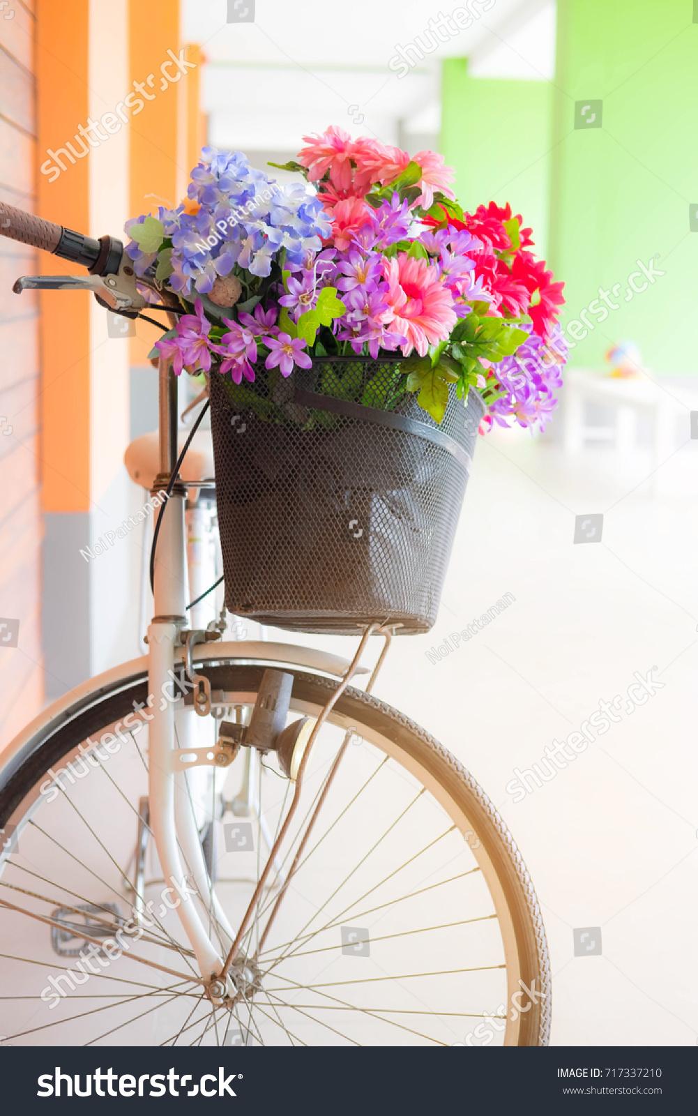 Famous beautiful fake flowers photos images for wedding gown ideas beautiful fake flowers basket old white stock photo 717337210 izmirmasajfo Choice Image
