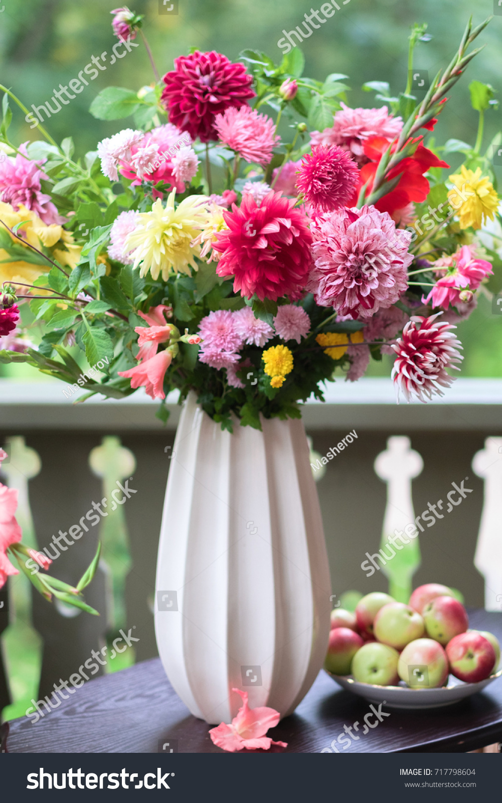 Bouquet asters dahlias flowers white vase stock photo royalty free bouquet of asters and dahlias flowers in a white vase standing on table vintage composition izmirmasajfo Gallery
