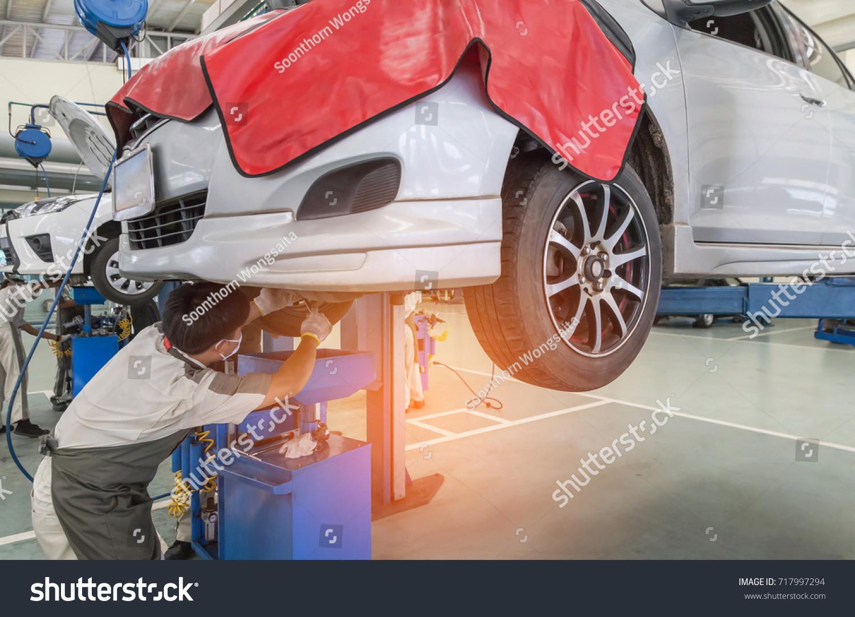 Car On Lift Repair Suspension Garage Stock Photo 717997294