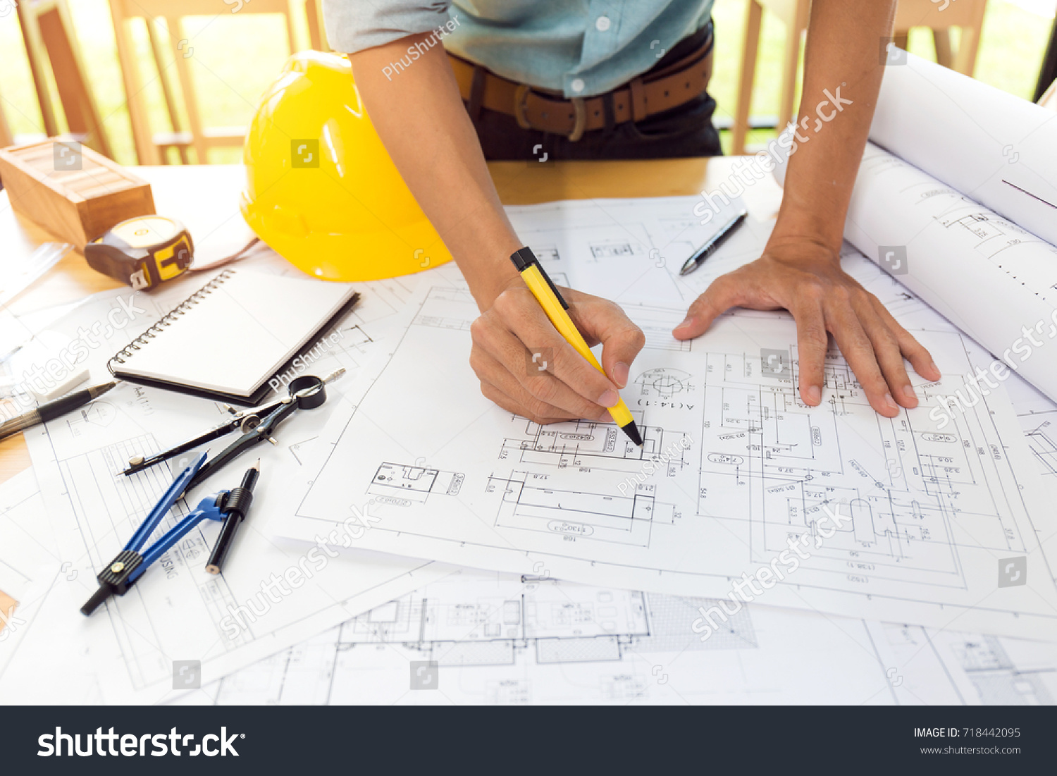 Team construction engineer working hard project imagen de archivo team of construction engineer working hard project blueprint to build large commercial buildings and golf course malvernweather Gallery