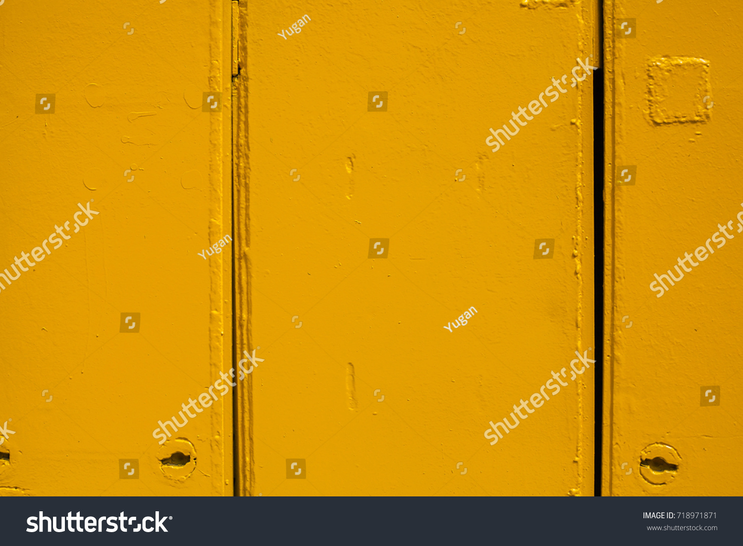 Bright red background. Paint smudges on the surface. Painted metal surface. The surface of the train as a background element. Metal painted yellow. Yellow metal sheets. Old painted surface