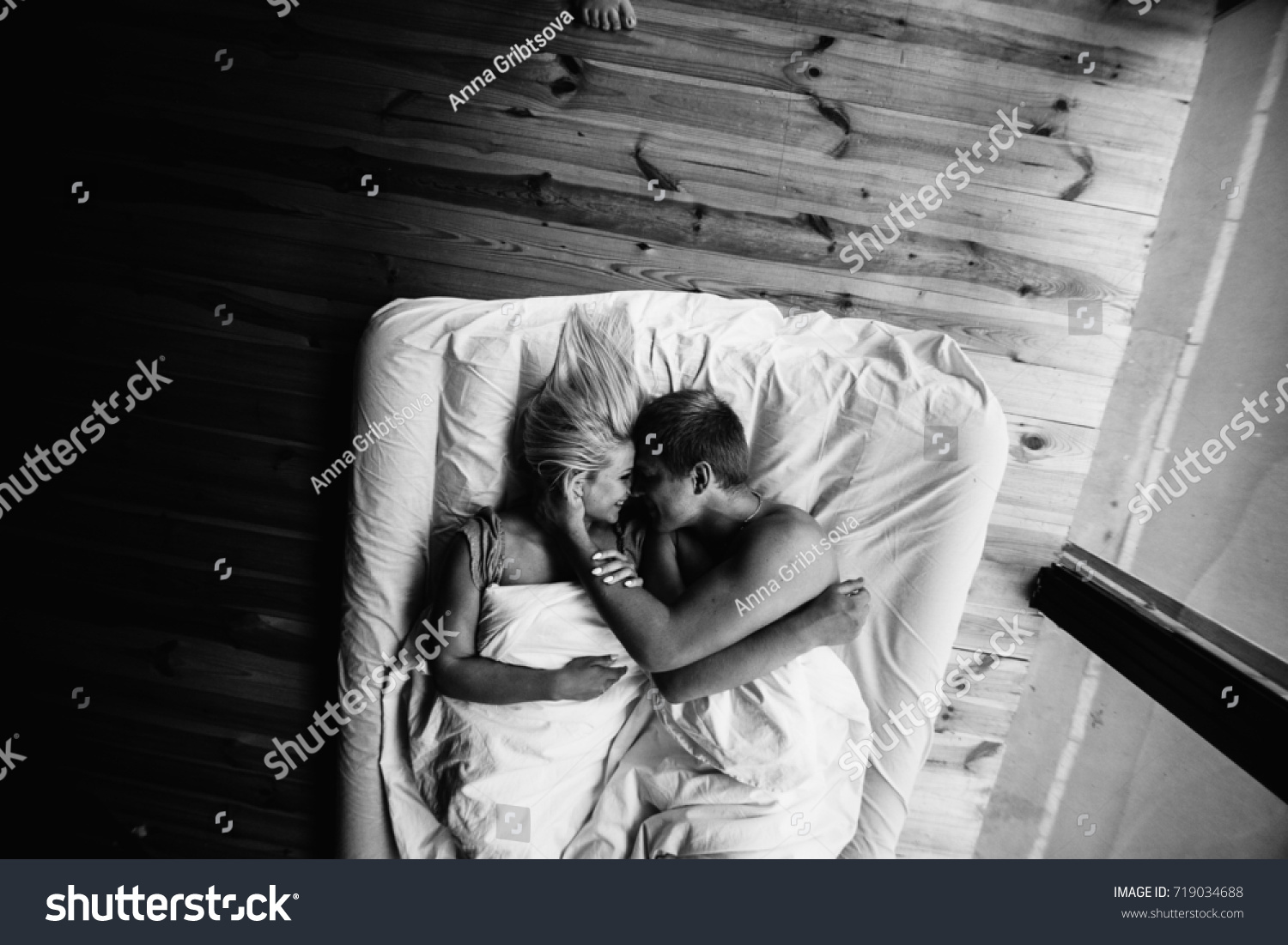 Young romantic couple in love have fun and hugs in the white bed love and