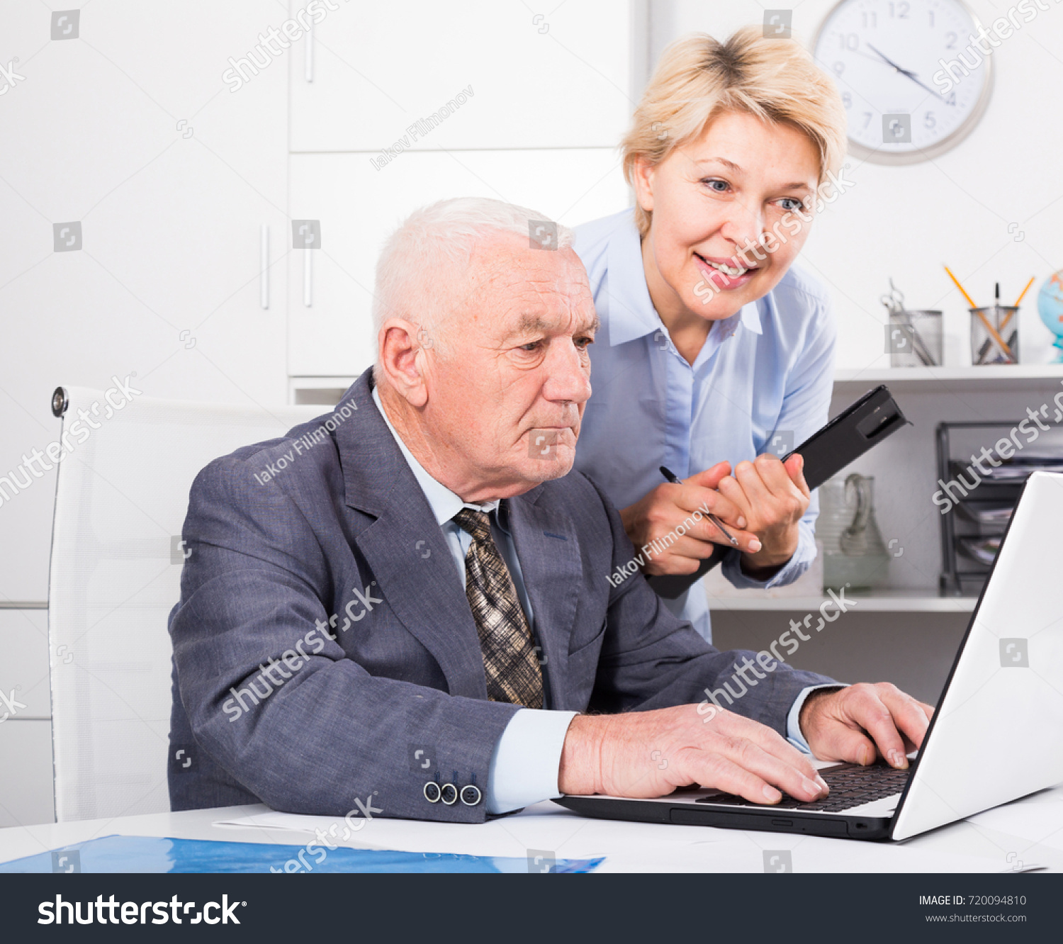 mature manager secretary having productive day stock photo (royalty