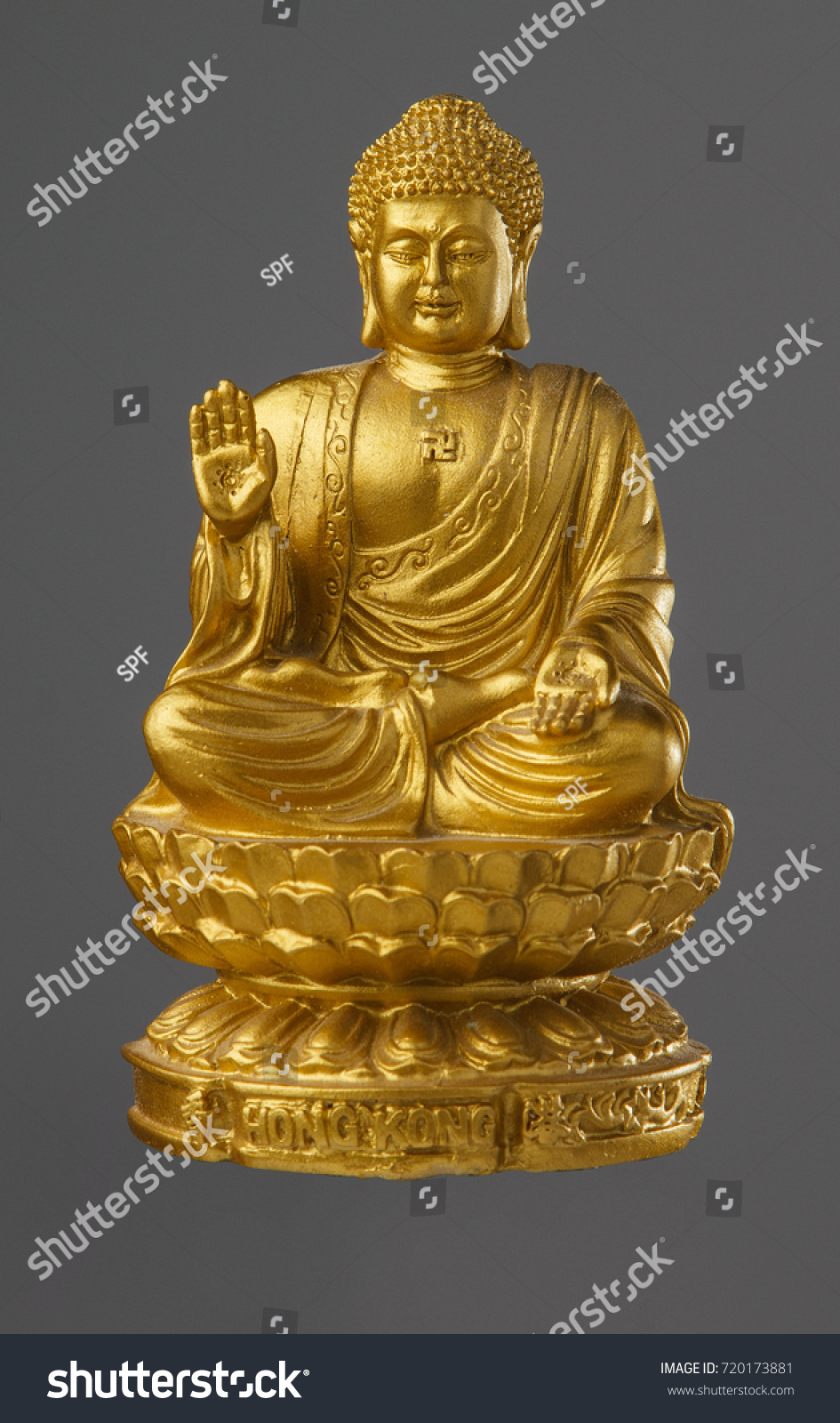 The Statue Of The Golden Buddha Sitting On A Lotus Flower And The