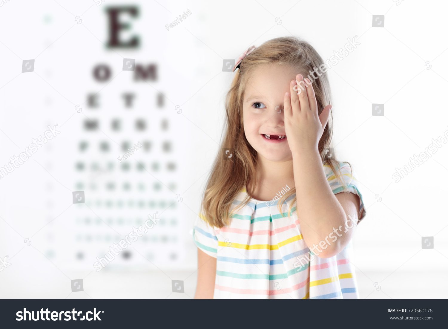 Child eye sight test little kid stock photo 720560176 shutterstock child at eye sight test little kid selecting glasses at optician store eyesight measurement geenschuldenfo Images