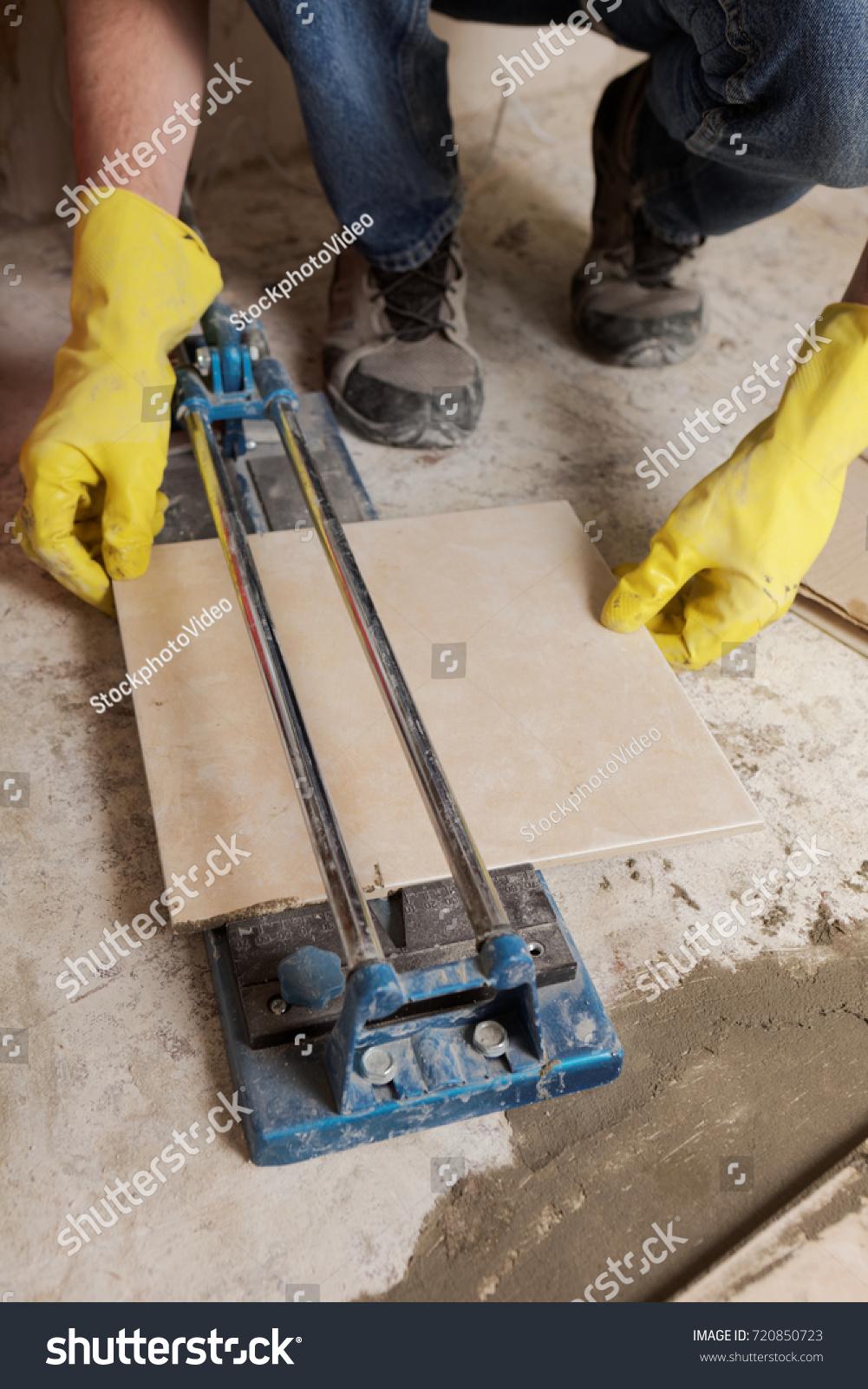 Tiler Installs Ceramic Tiles On A Floor Ez Canvas