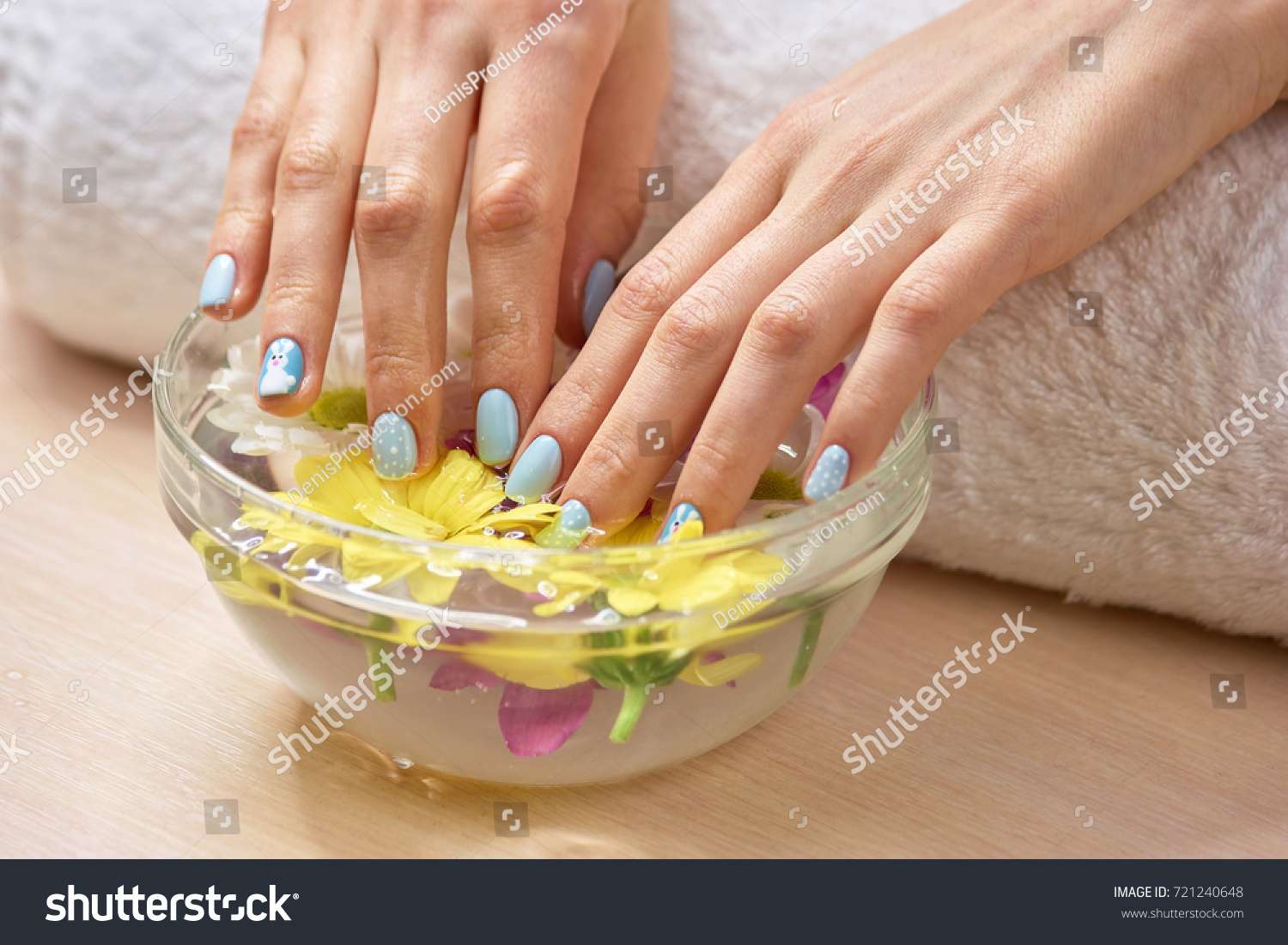 Female fingernails soaking hand bath beautiful stock photo female fingernails soaking in hand bath beautiful young woman hands with winter design nails in prinsesfo Images