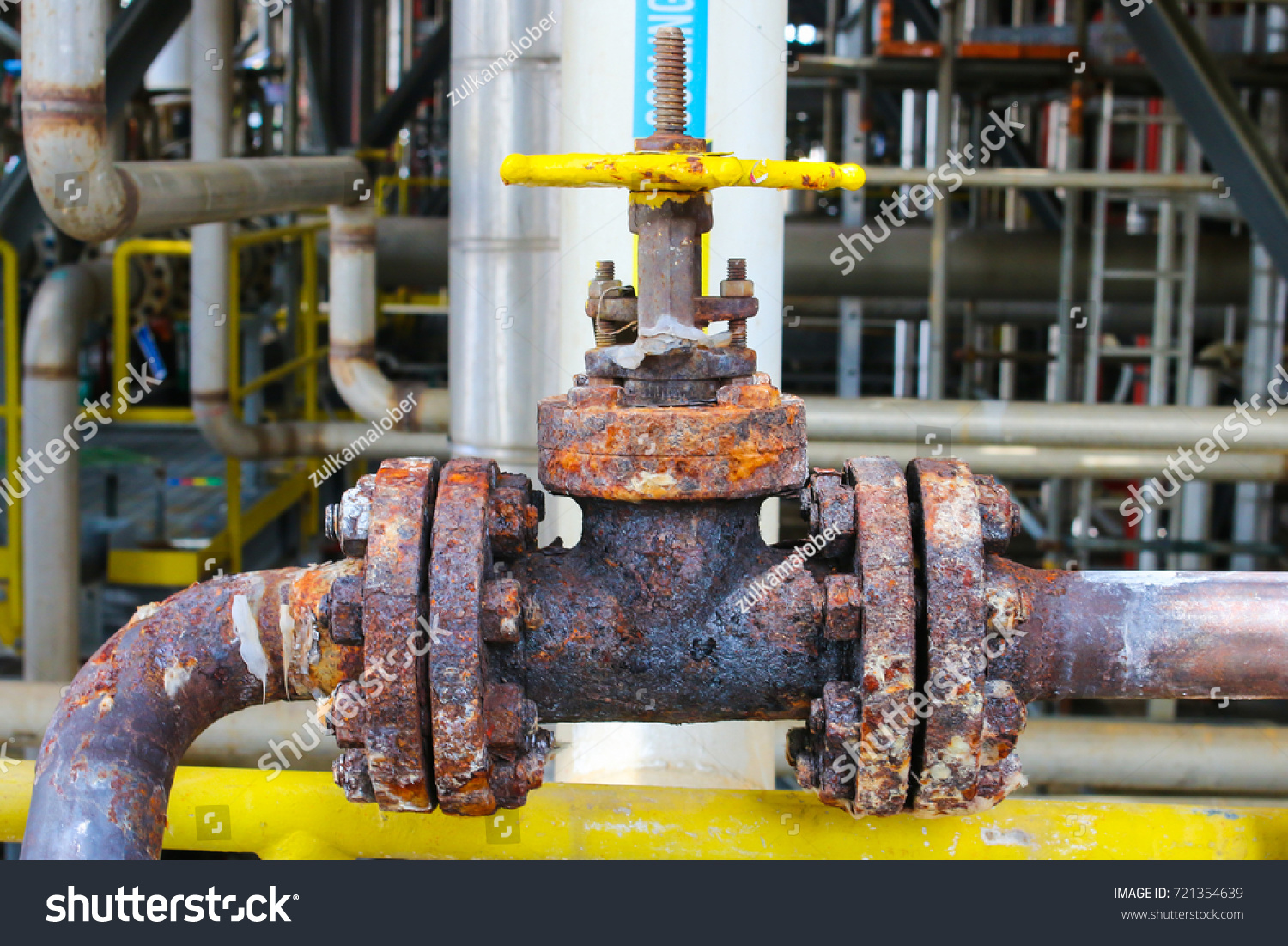 A heavily corroded manual valve in oil and gas refinery petrochemical plant.