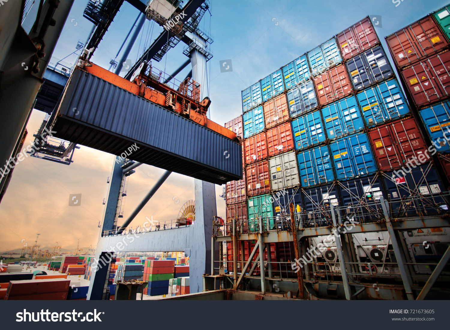 Container loading in a Cargo freight ship with industrial crane. Container ship in import and export business logistic company. Industry and Transportation concept. #721673605
