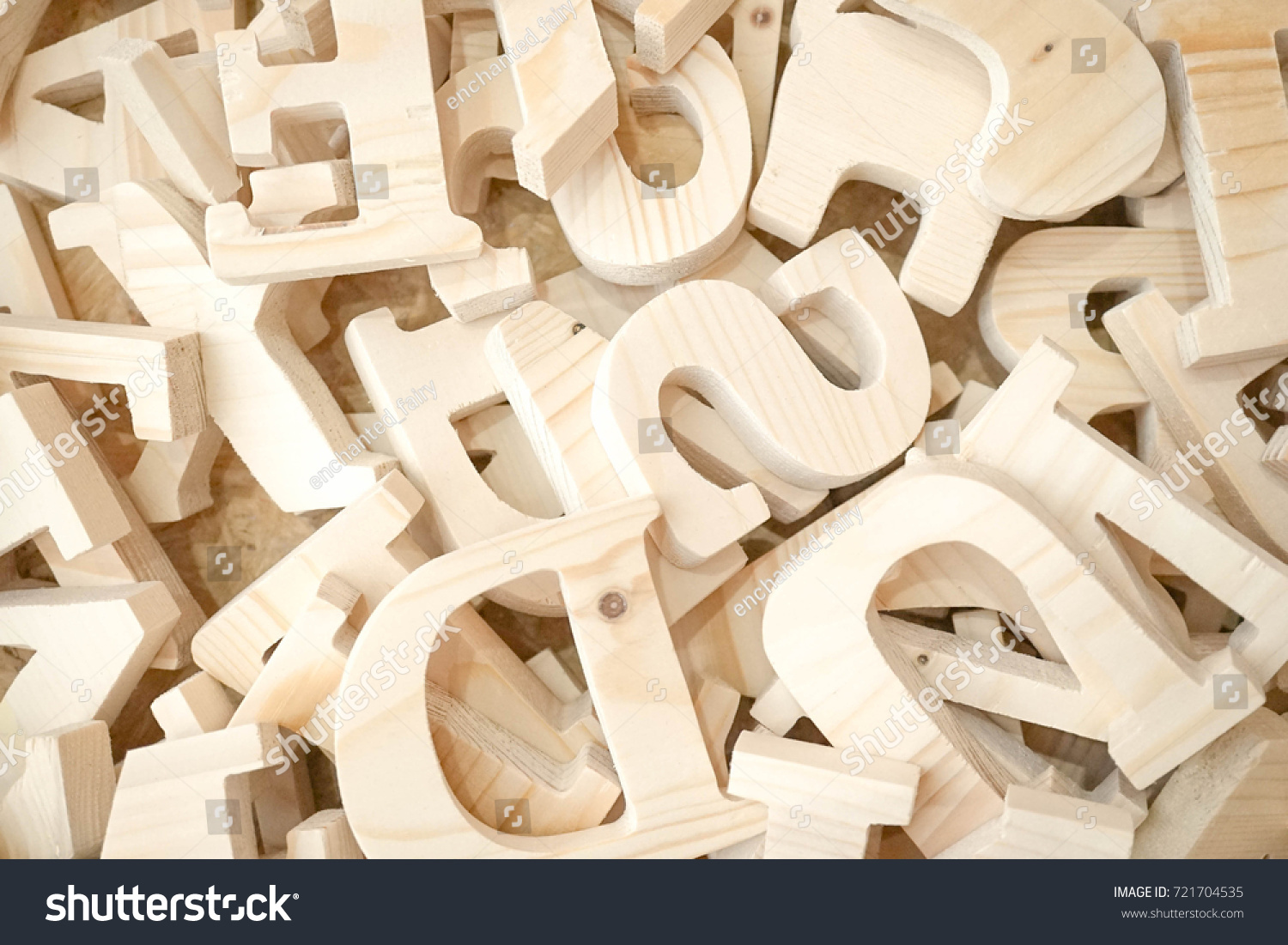 Wooden alphabets pile wooden english alphabet stock photo royalty a pile of wooden english alphabet in capital letters keyword can be solutioingenieria Images