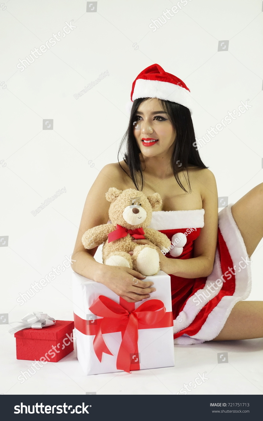 8c7be25c902c1 The woman with Santa dress and Santa Hat and teddy bear and gift boxes.  Women