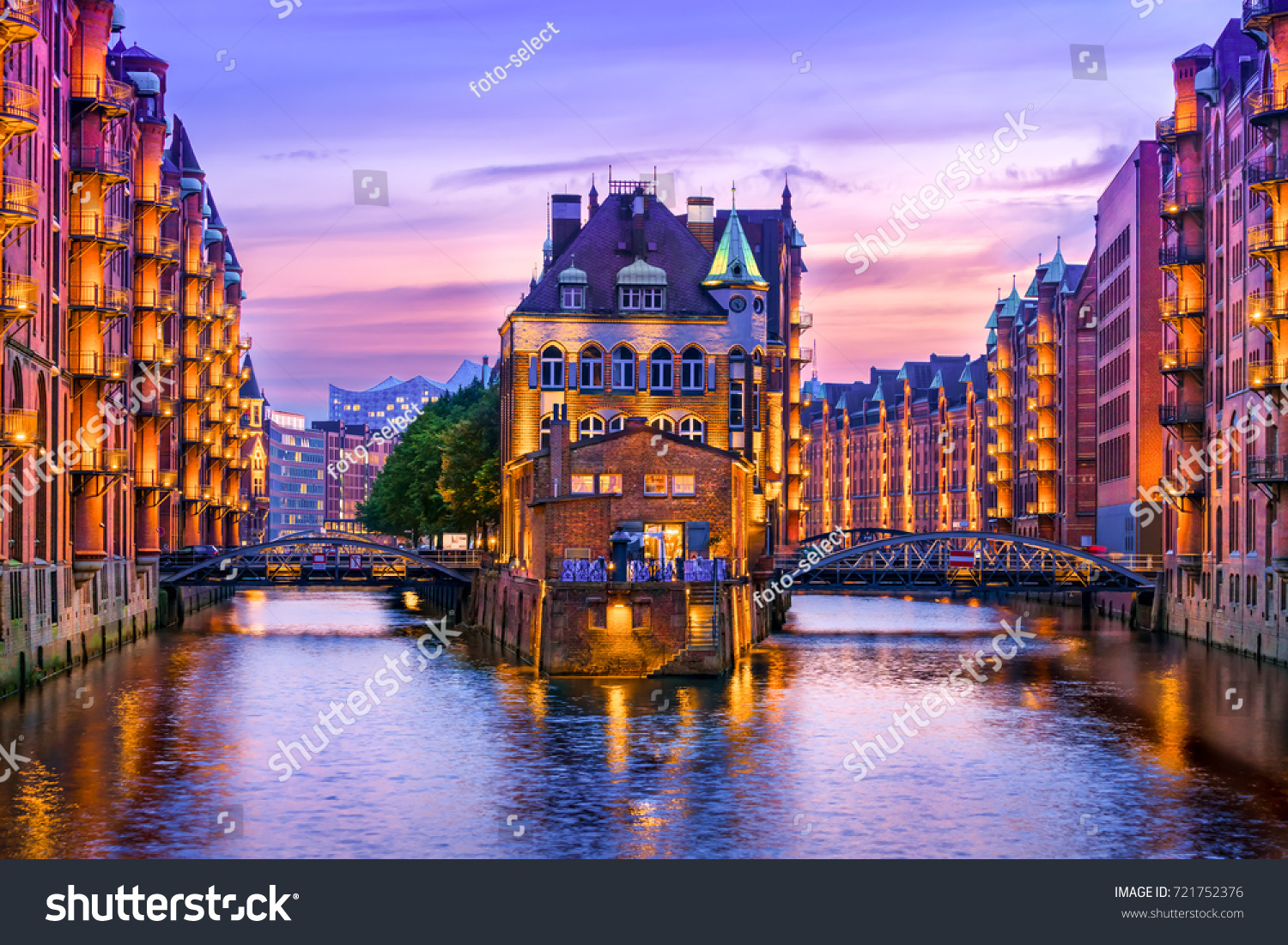 The Warehouse District (Speicherstadt) in Hamburg, Germany, at dusk. View of Wandrahmsfleet. The largest warehouse district in the world is located in the port of Hamburg within the HafenCity quarter. #721752376