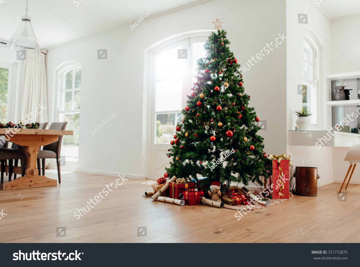 Interior Of Living Room Decorated For Christmas. Decorated Christmas Tree  With Gifts All Around It Part 73
