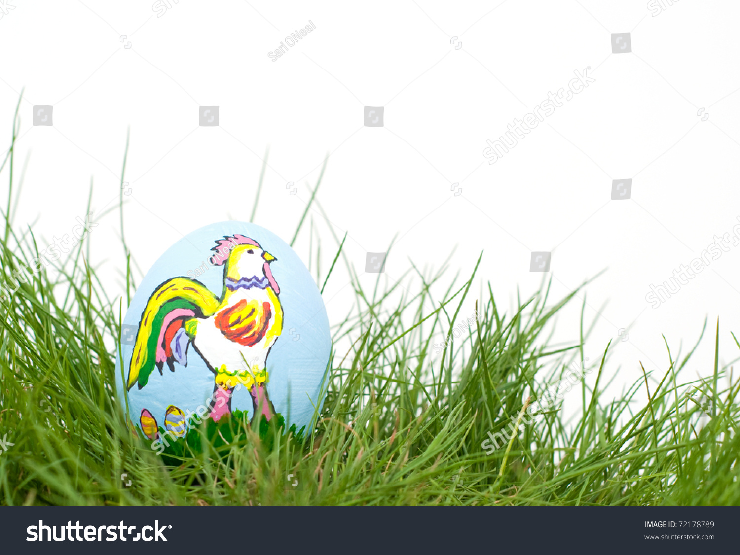 stock-photo-colorful-easter-rooster-hand