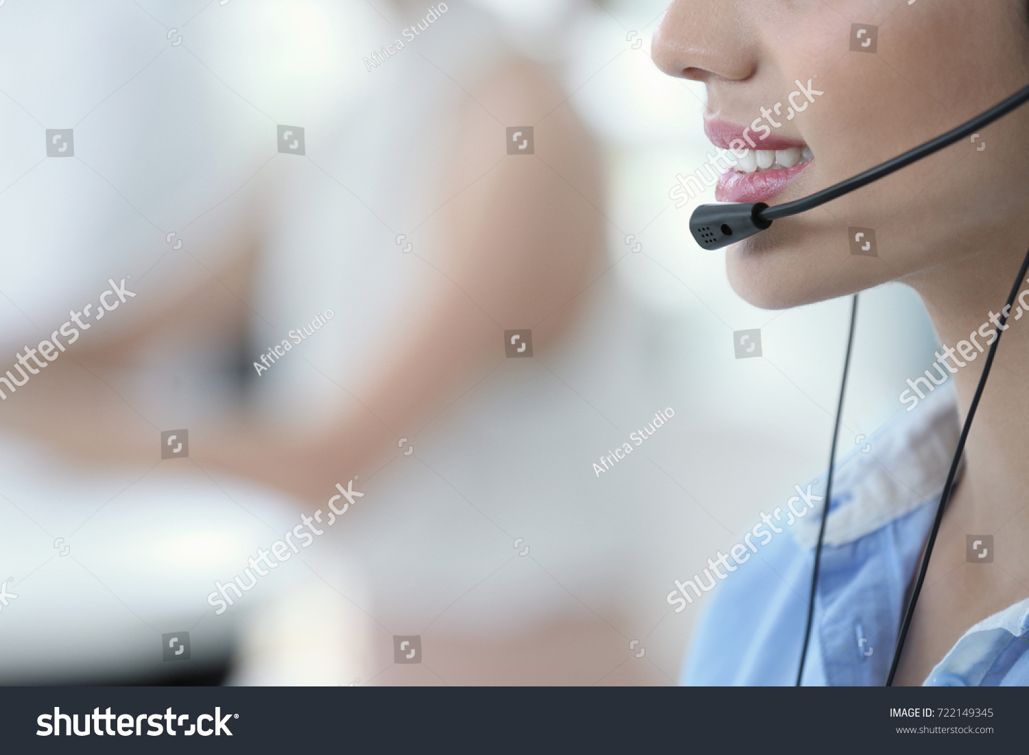 Young female technical support dispatcher working in office, closeup #722149345