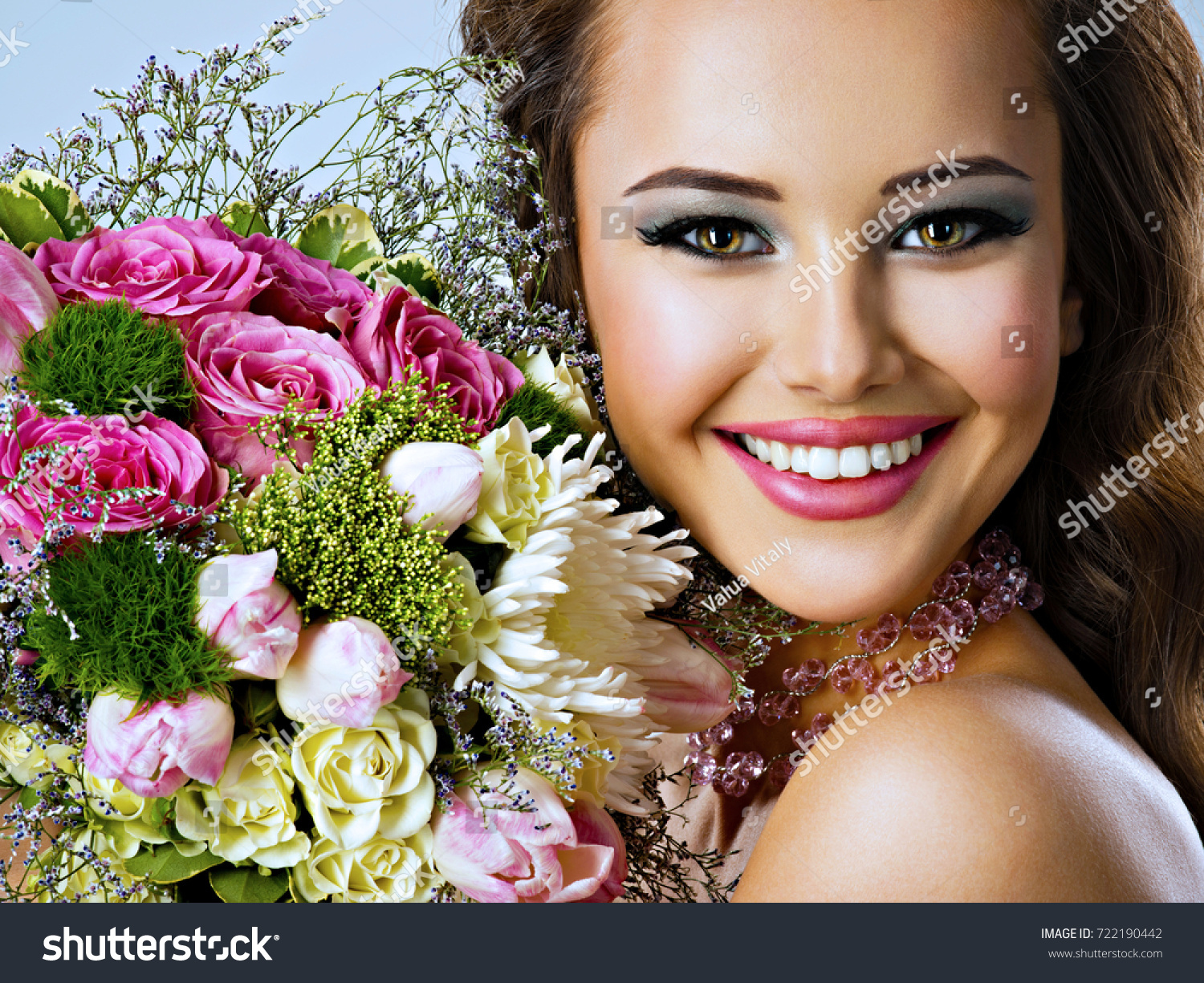 Closeup portrait beautiful happy girl flowers stock photo edit now closeup portrait of beautiful happy girl with flowers in hands young attractive woman holds the izmirmasajfo