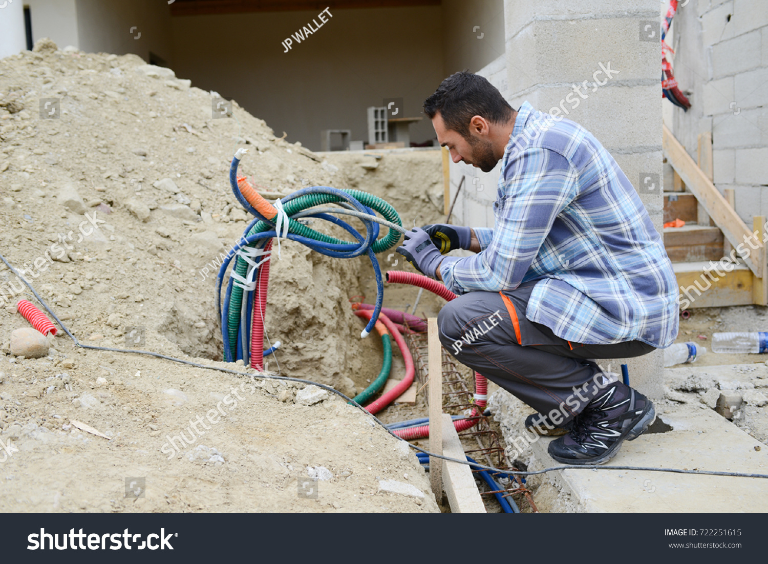 Handsome Young Man Electrician Wiring Cable Stock Photo Edit Now For A House Outdoor In Building Construction Site