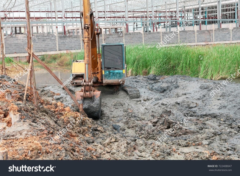 Backhoe Working Mud Stock Photo (Edit Now) 722408047