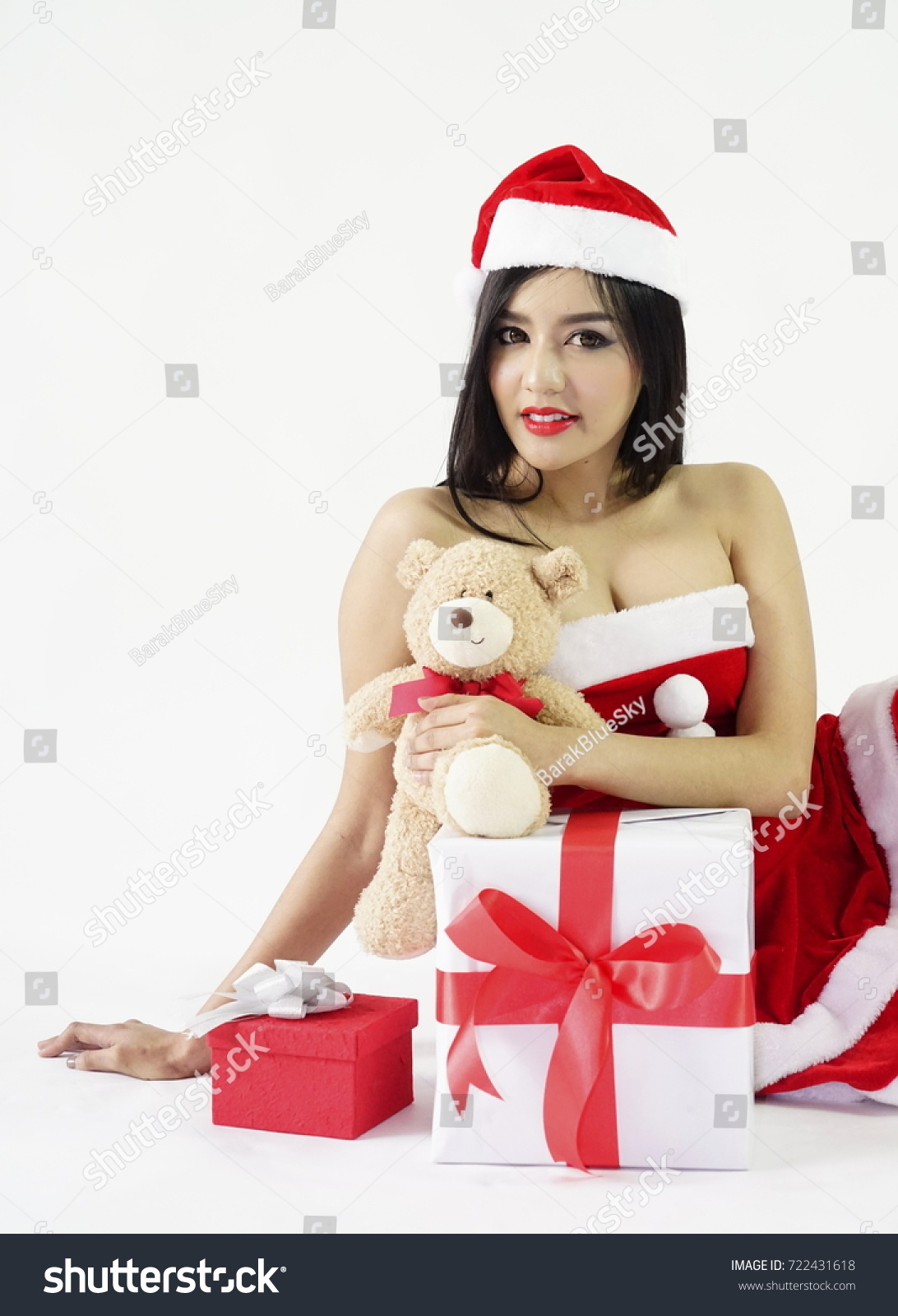 eb4f764868ed6 Sexy woman wear red Santa dress and Santa hat with gift boxes and teddy bear  on