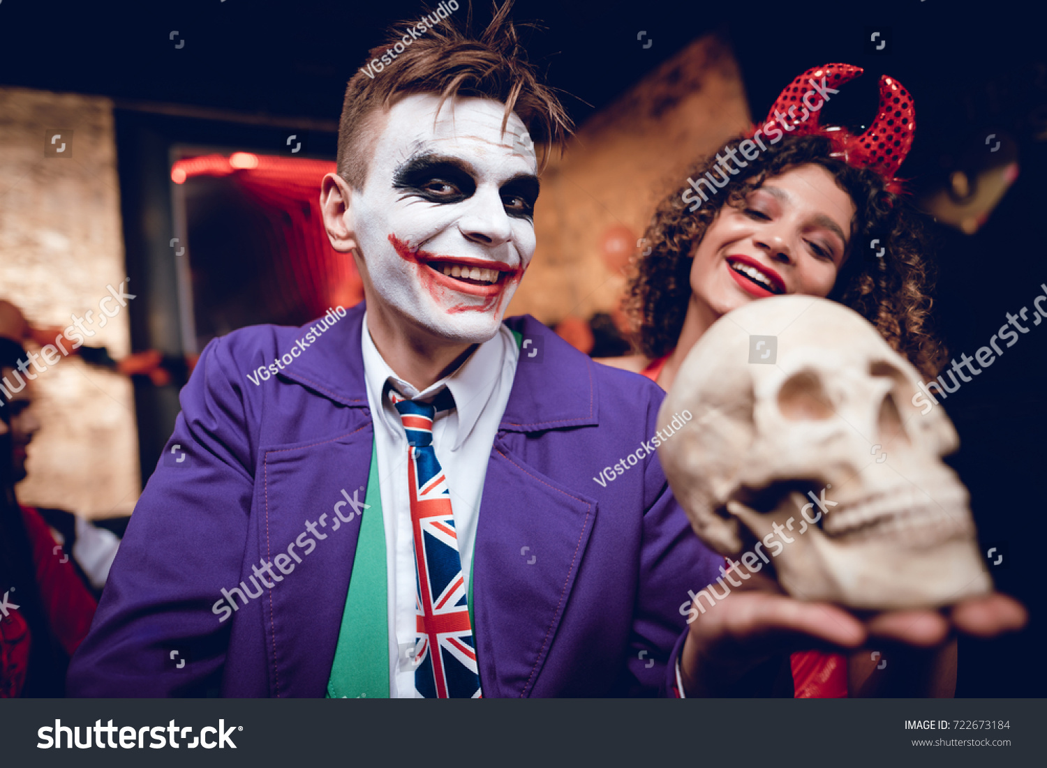 A guy in a Joker costume and a girl in a demon costume posing with a  sc 1 st  Shutterstock & Guy Joker Costume Girl Demon Costume Stock Photo (Royalty Free ...