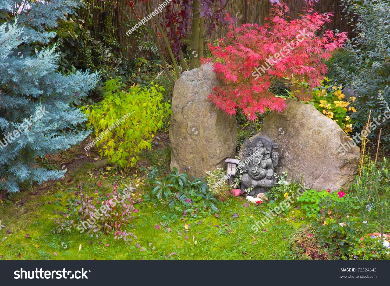 Ganesh Statue In An Asian Garden