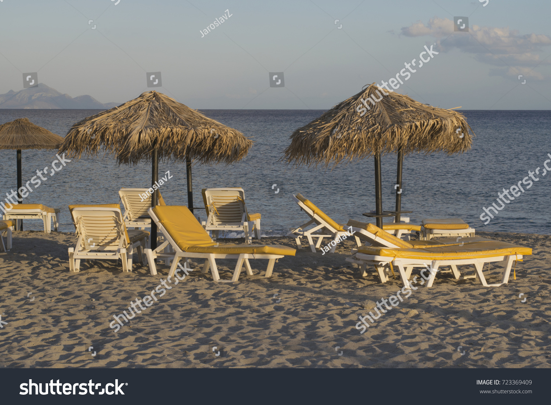 stock-photo-summer-sun-bed-and-umbrella-