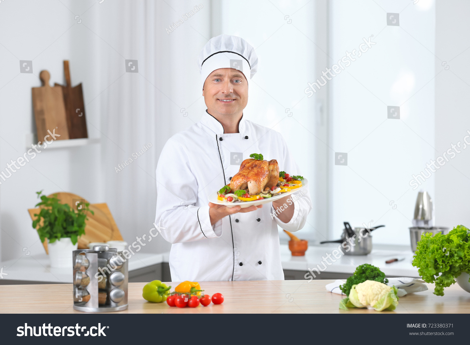 Male Chef Holding Plate Cooked Chicken Stock Photo (Download Now ...