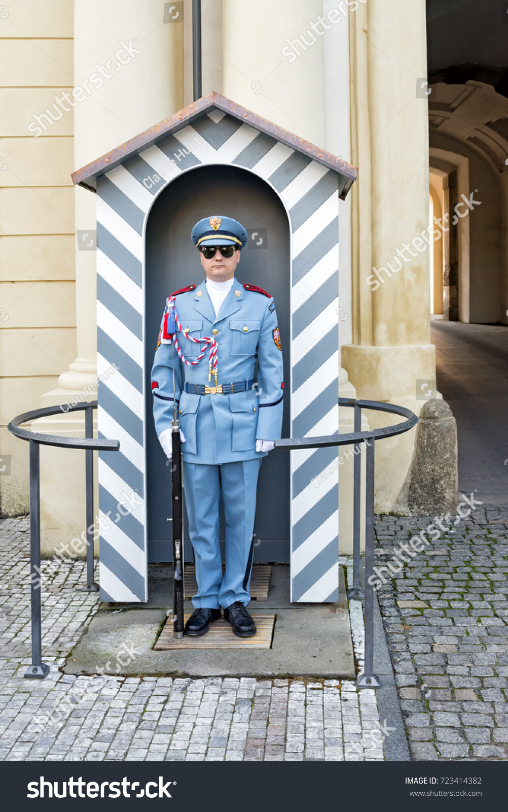 PRAGUE, CZECH REPUBLIC - SEPTEMBER 5, 2017: Military guard stands at attention at the Imperial Stables entrance of the Prague Castle complex which includes the presidential residence.