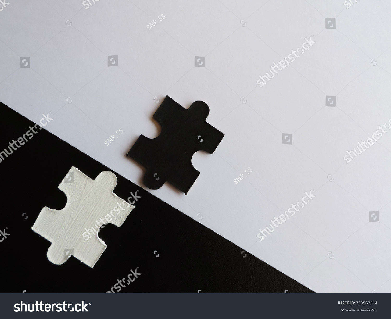 Two Jigsaw Puzzle PiecesBlack Piece And White