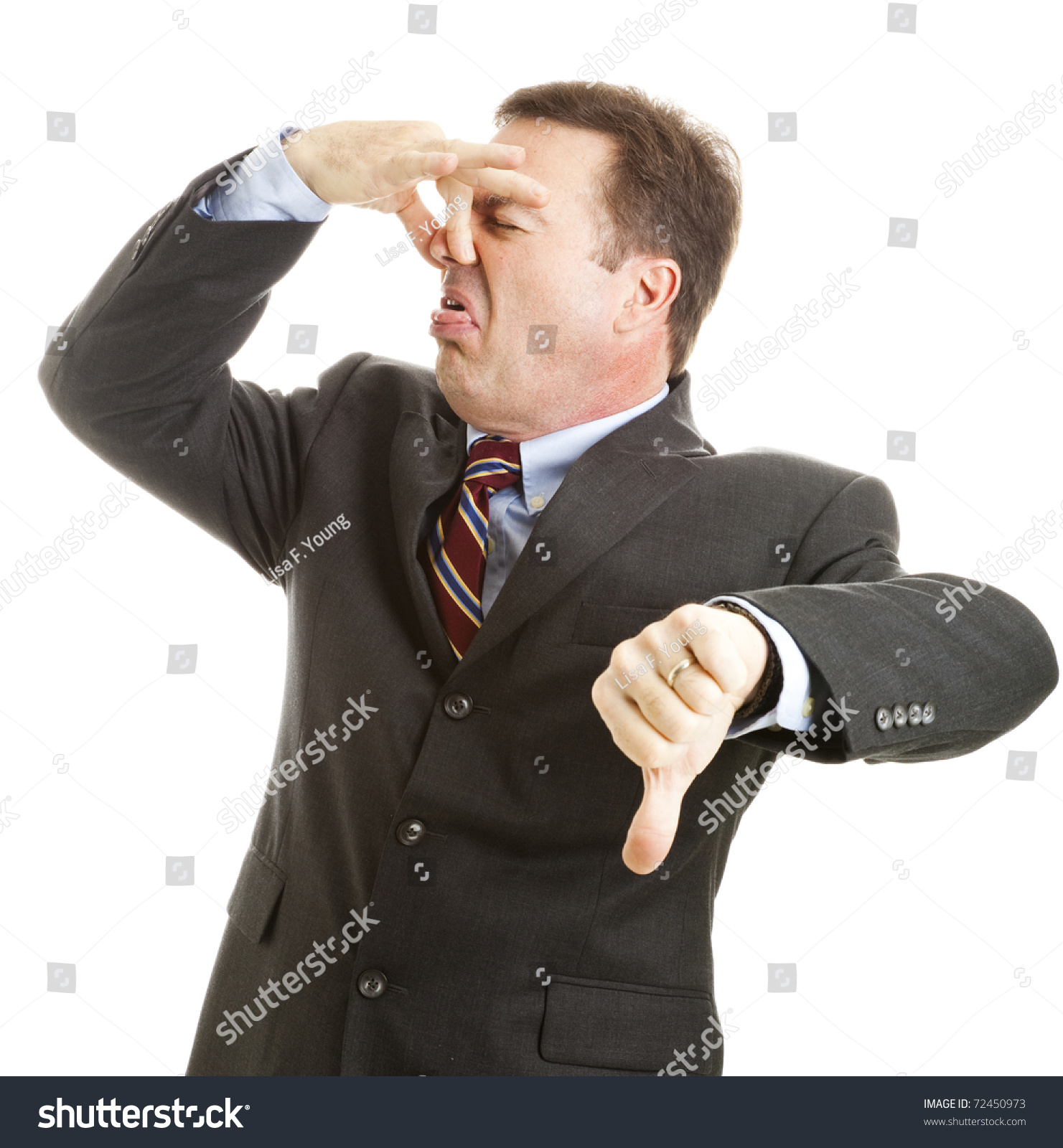 foto de Mature Businessman Holds His Nose And Gives A Thumbs Down