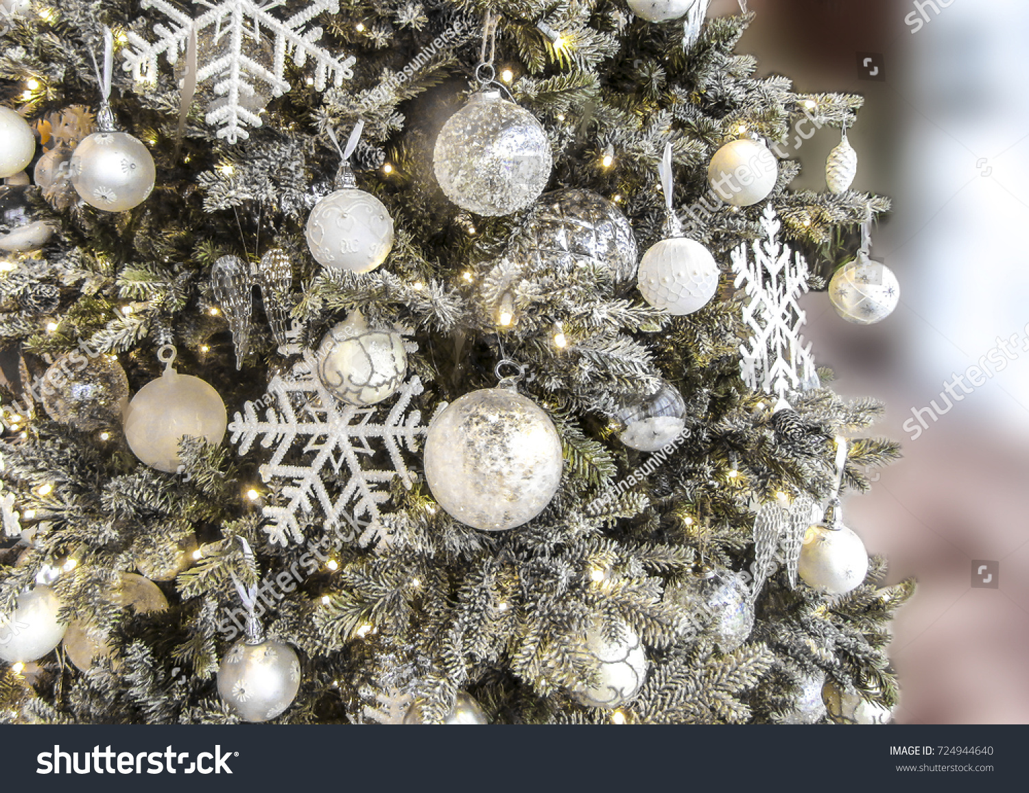 Christmas tree background decorated with balls stars and lights