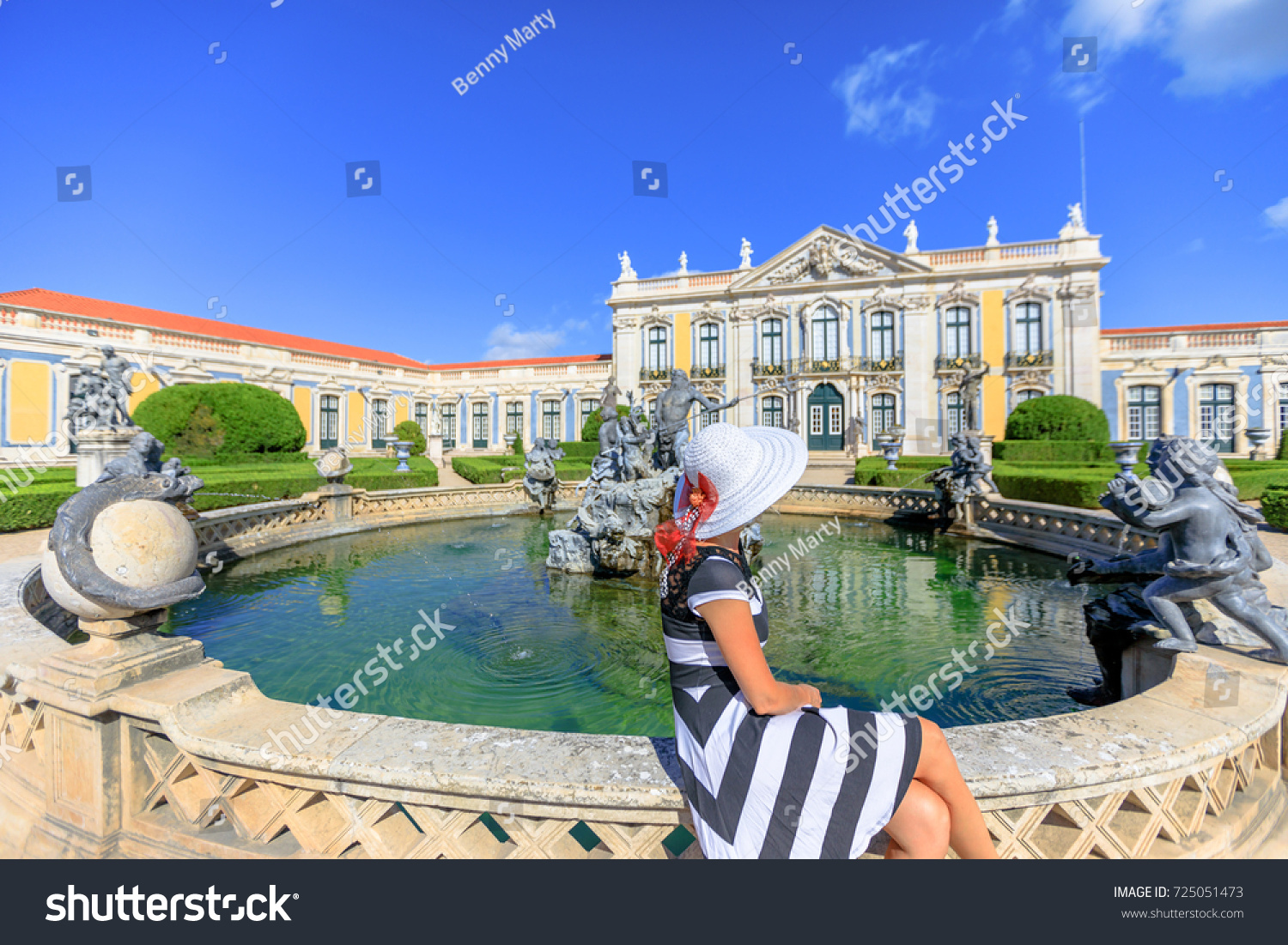 Elegant Woman Sitting In Neptune Gardens Of Queluz National Palace Or Royal
