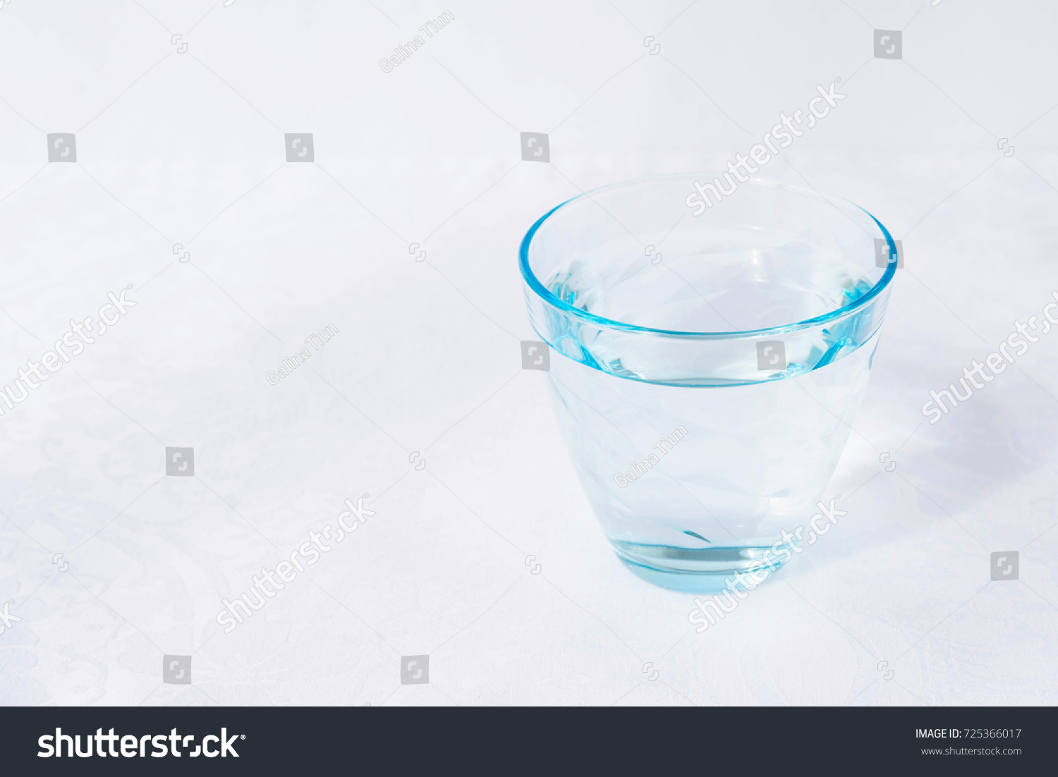 Glass of water on a white background #725366017