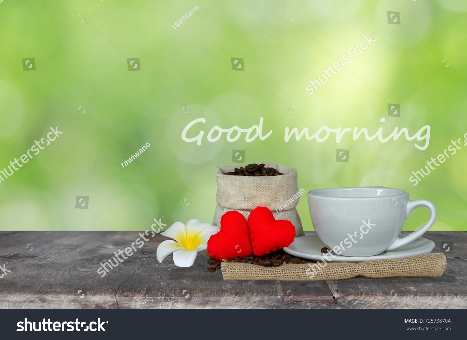 good morning coffee with love concept hot coffee cup with coffee beans sack white