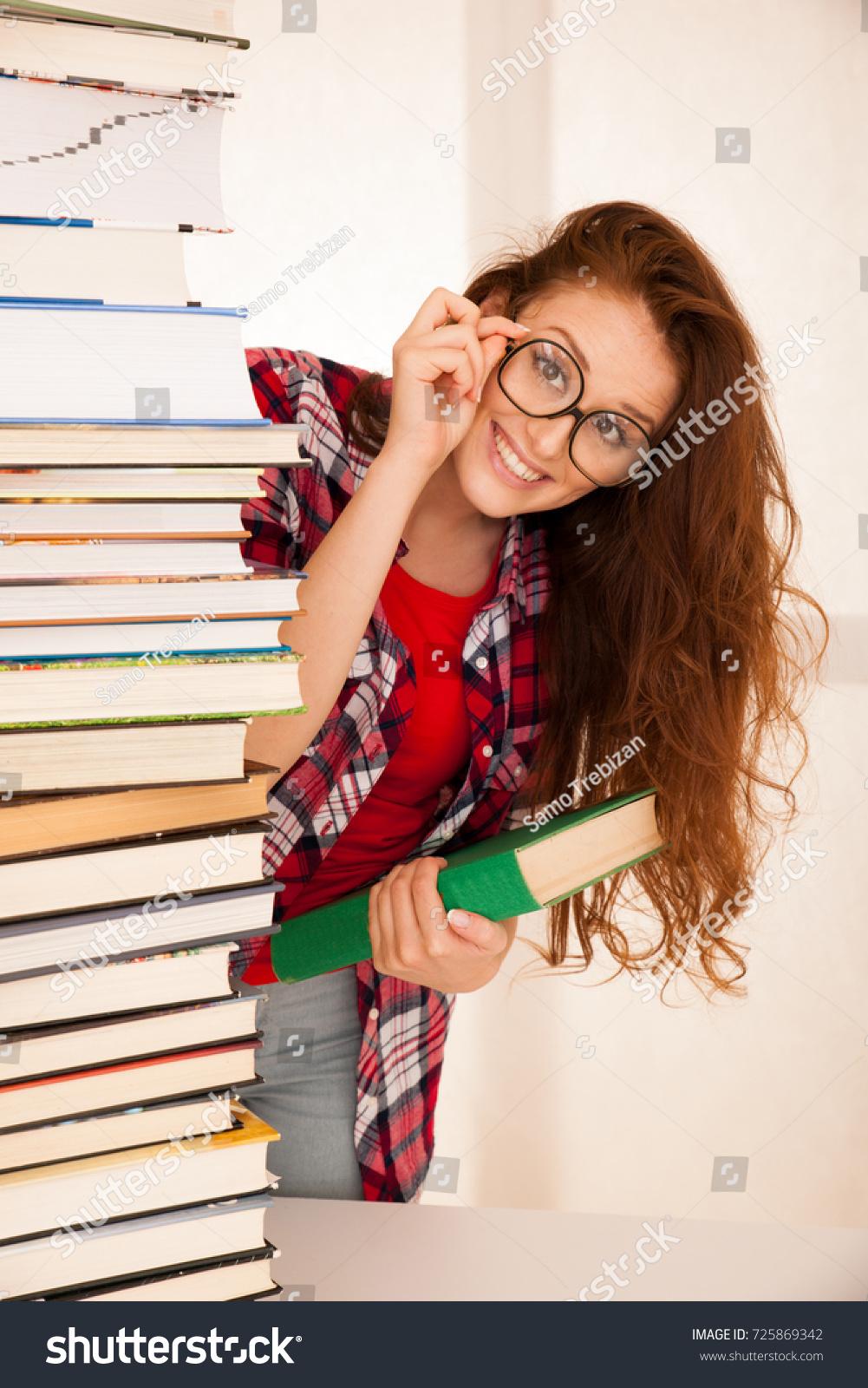 Geekin Gorgeous attractive beautiful woman geek study pile stock photo (edit