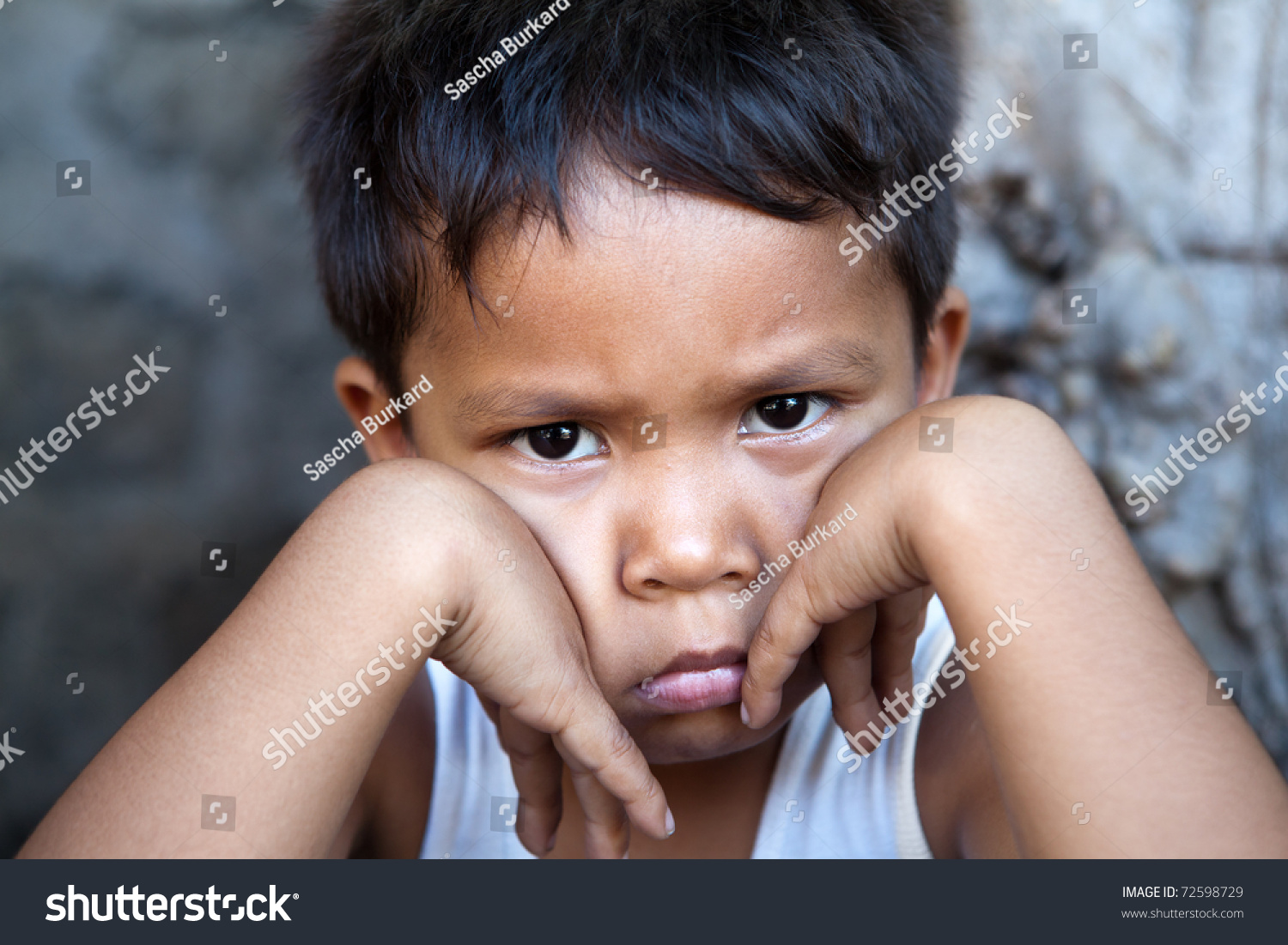 young filipino boy sad expression against stock photo edit now