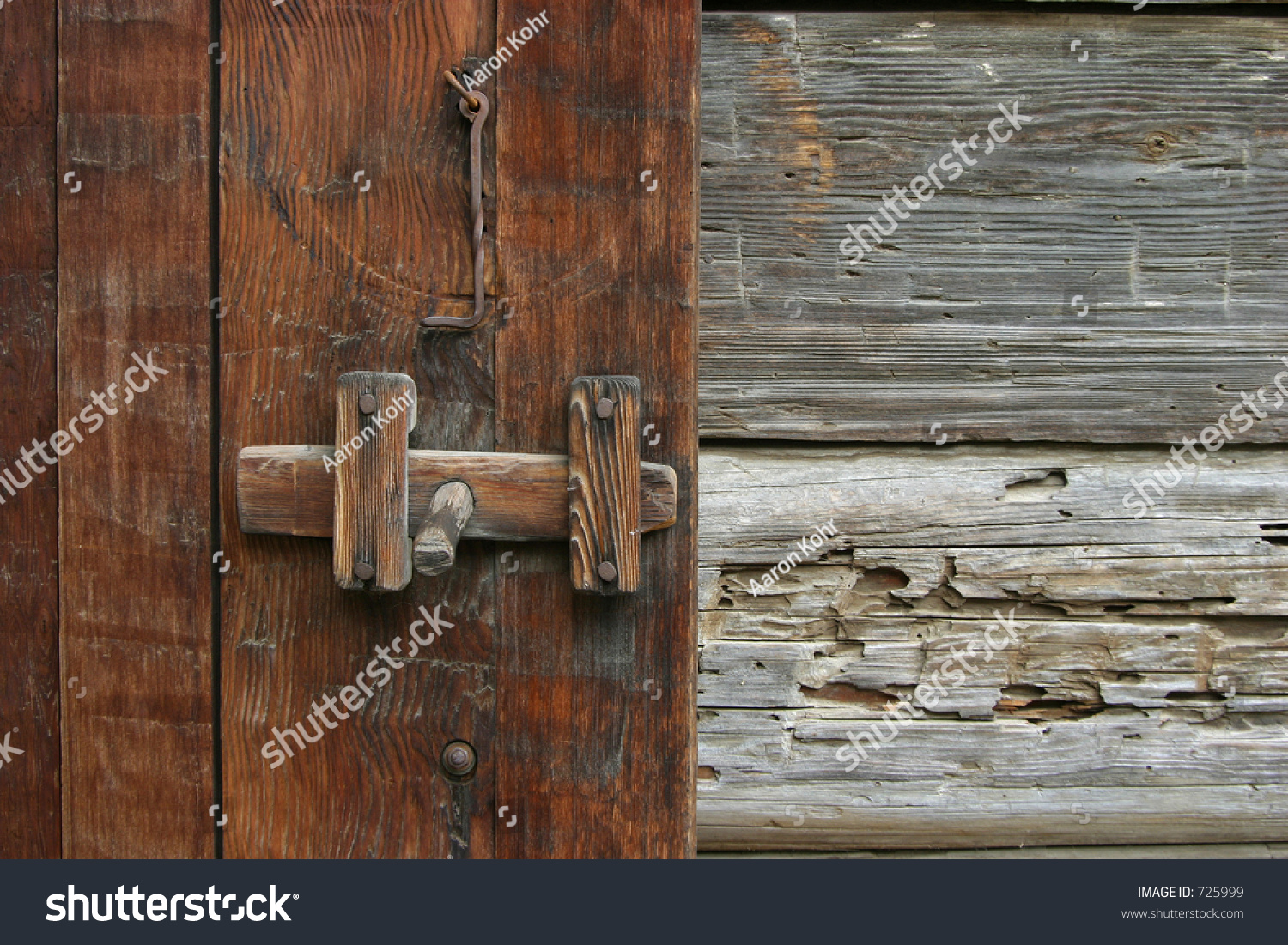 A Very Old And Rustic Door Latch On An Early American