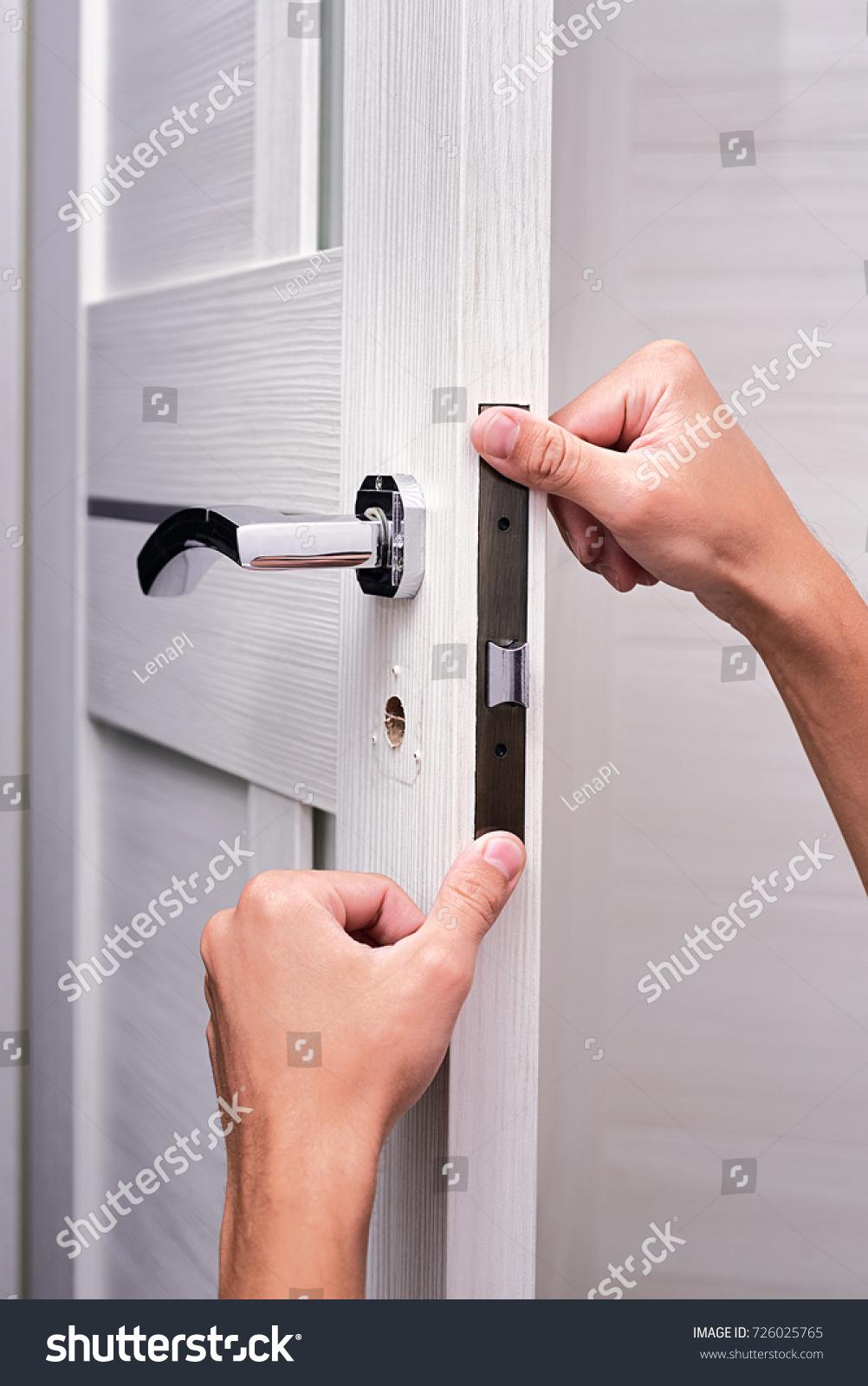 handyman repair the door lock in the room Man fixing lock with screwdriver Close & Handyman Repair Door Lock Room Man Stock Photo (Download Now ...
